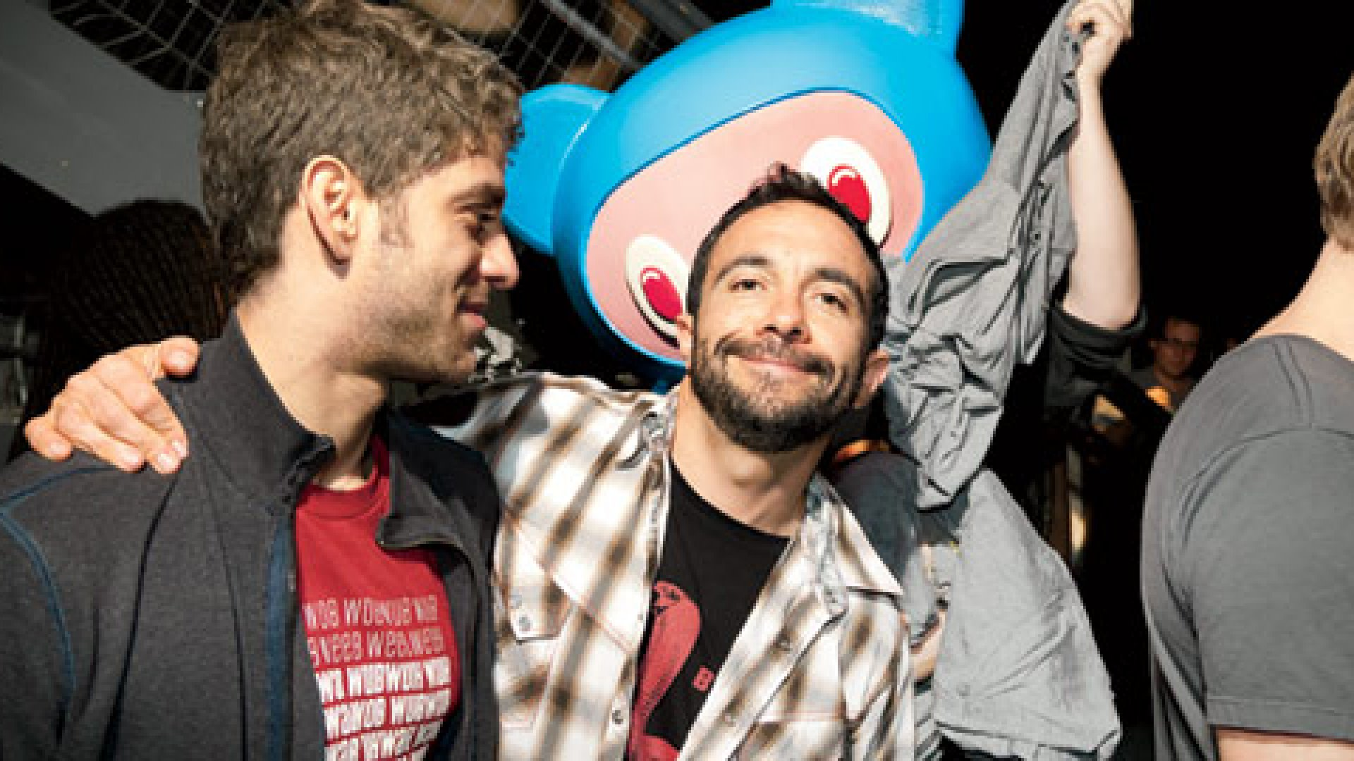 <b>THE ARTIST AND THE BUSINESS GUY:</b> Billy Chasen (left) and Seth Goldstein at a SXSW party hosted by their company, Turntable.fm. The blue bear represents an avatar from the site.