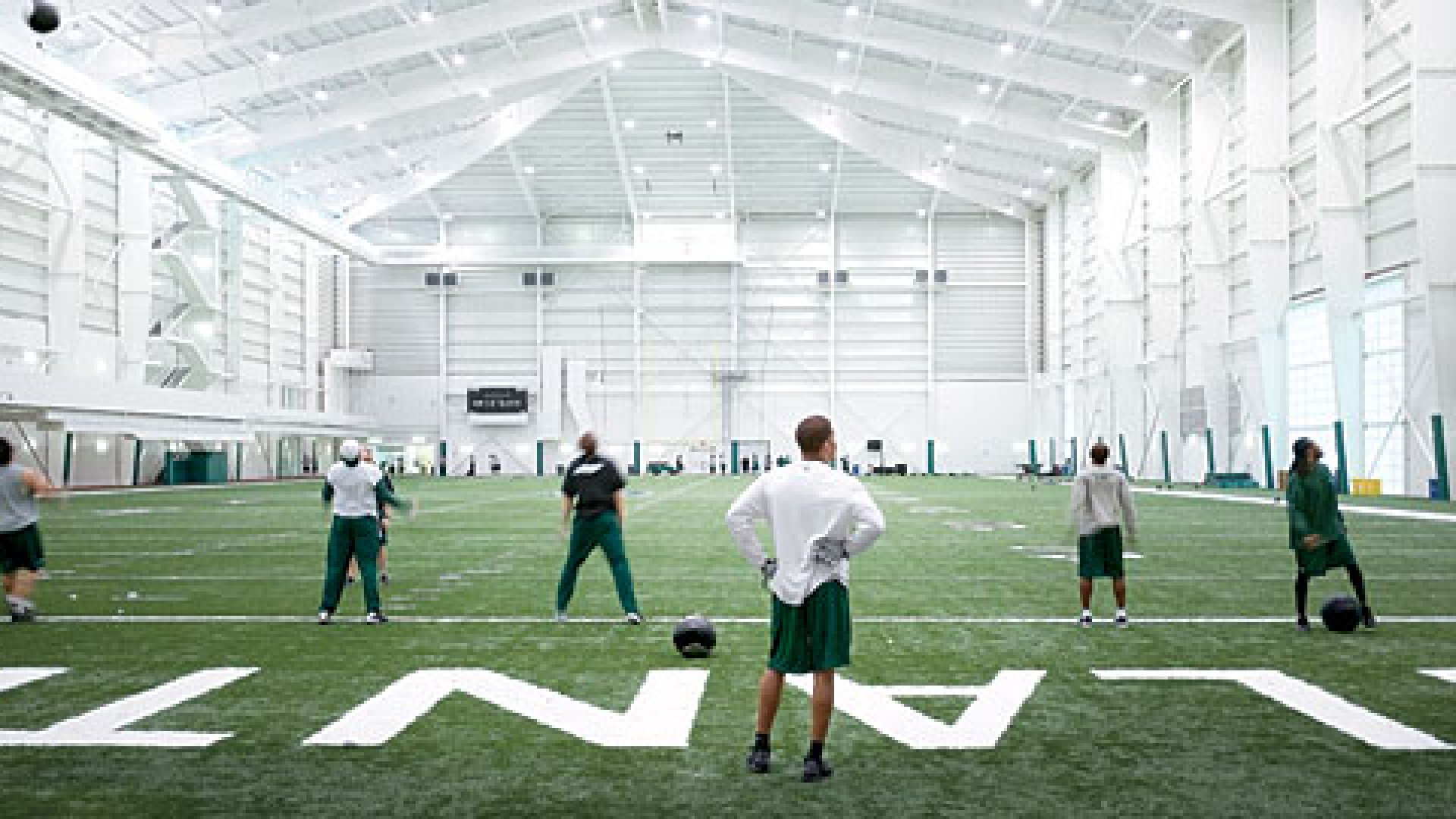 <strong>TAKING THE FIELD: </strong>Yes, the fieldhouse is for the players first. But when the players are not using it, employee intramural sports teams take the field.