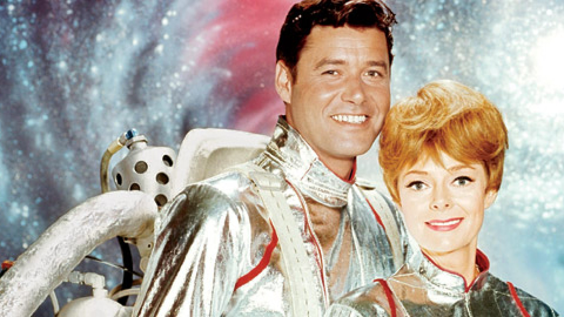Professor John Robinson (sporting his jetpack) and Dr. Maureen Robinson in 1965's <em>Lost in Space</em>