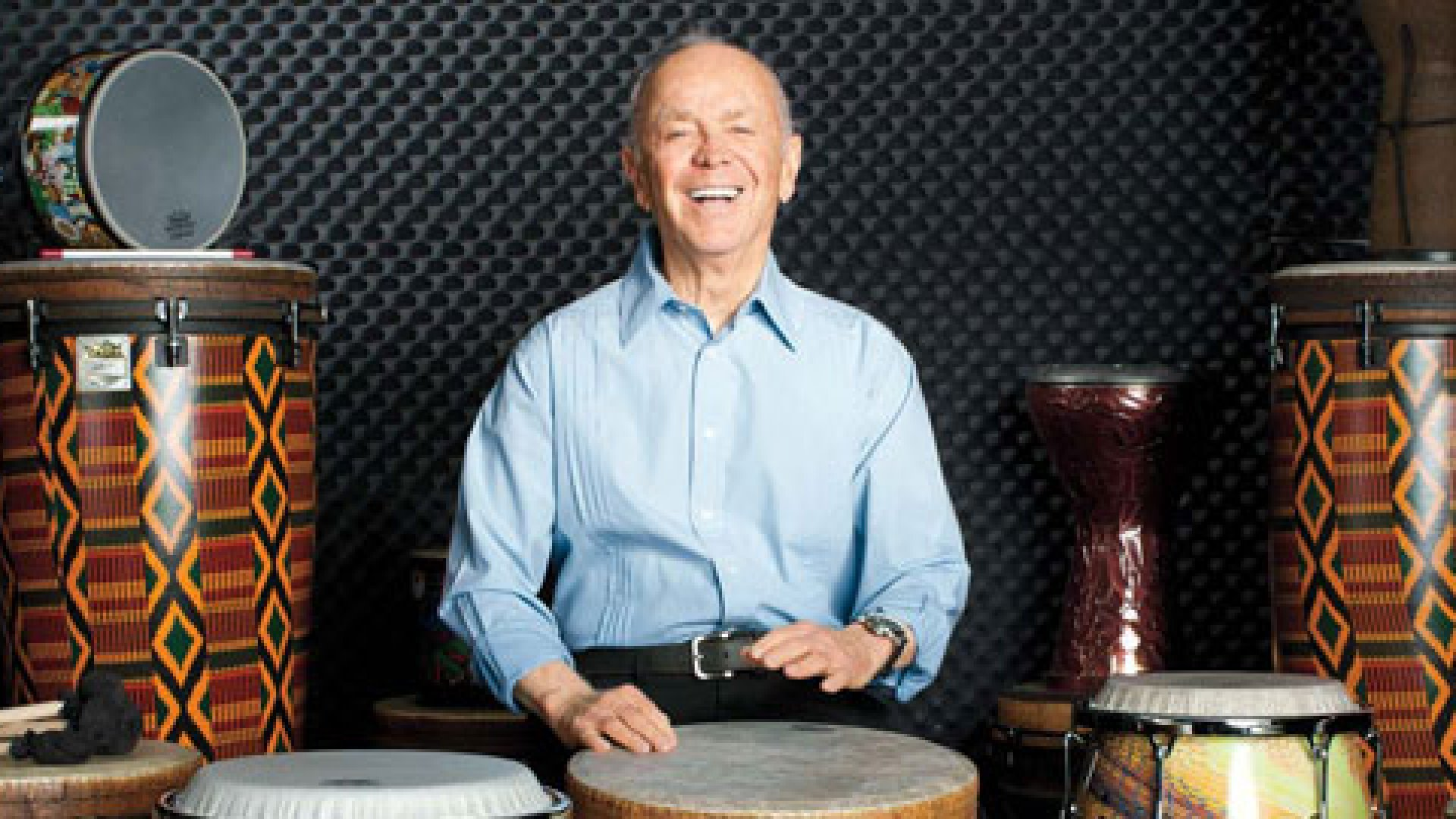 <strong>Crazy for Drums</strong> Remo Belli has some fun on a Remo <em>djembe,</em> part of the company's World Percussion collection.