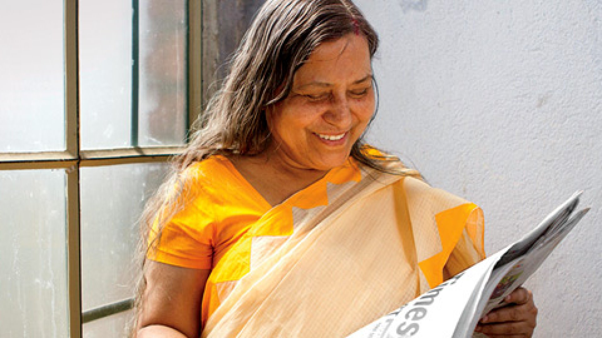 <b>Good News</b> For 30 years, Sunanda Chakraborty suffered from blurry vision and severe headaches. She had a cornea transplant in 2010, and now she can engage in her favorite activity: reading the newspaper.