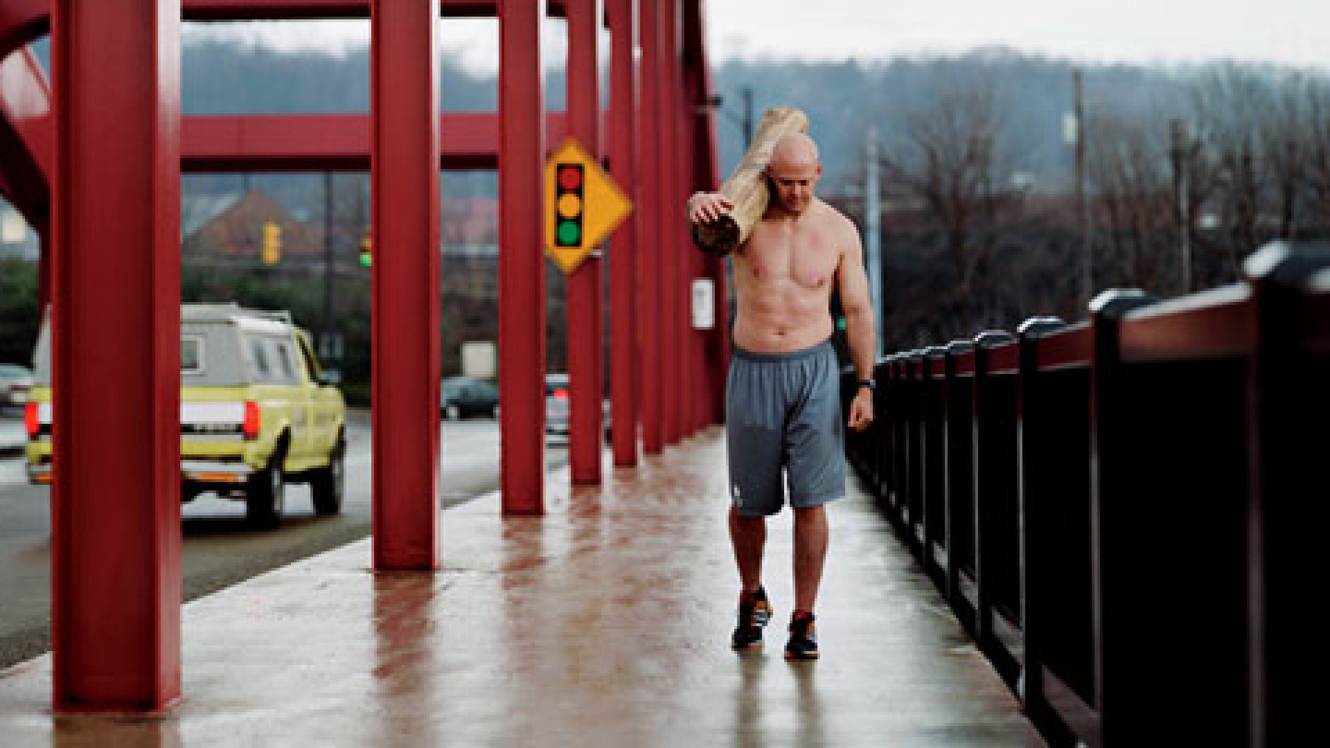 <strong>Tough Town</strong> Paul Dunleavy, an iconic figure in Youngstown, runs and walks through the streets carrying a 55-pound log in the spring of 2010. As he does it, he prays for his city.