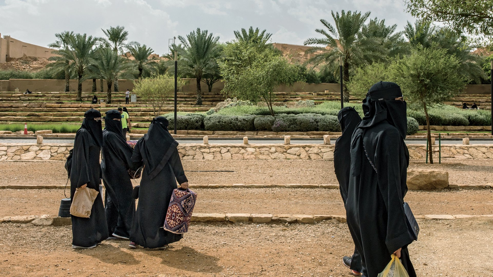 While some Saudi women have stopped covering their hair in public, many in Riyadh--like these, in Diriyah Park--still wear the hijab (headscarf) and niqab (facial veil). Social reforms are happening slowly--women are now allowed to drive, but they still can't leave the country without permission from a male guardian.