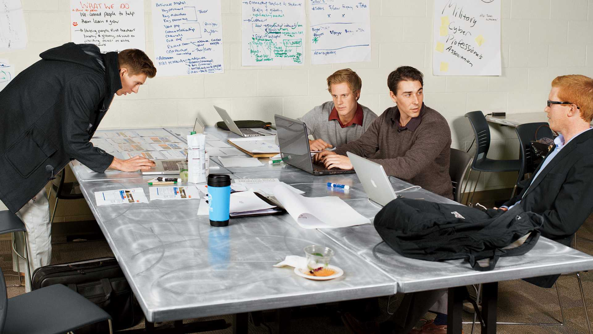 "<b>Go, Team:</b> The Wan2Learn group, one of 10 teams competing at Startup Weekend Monterey Bay, hunkers down. Its model, in a nutshell? ""Like Craigslist, only without sh--ty design."""