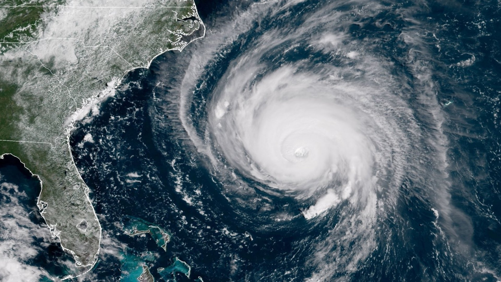 In this satellite image provided by U.S. National Oceanic and Atmospheric Administration (NOAA), Hurricane Florence churns through the Atlantic Ocean toward the U.S. East Coast on September 12, 2018.