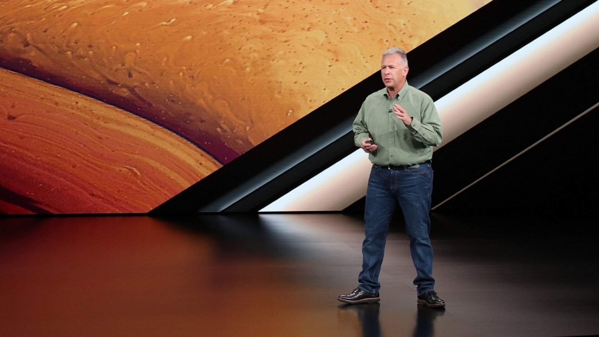 Phil Schiller, senior vice president of worldwide marketing at Apple Inc., speaks at an Apple event at the Steve Jobs Theater at Apple Park on September 12, 2018