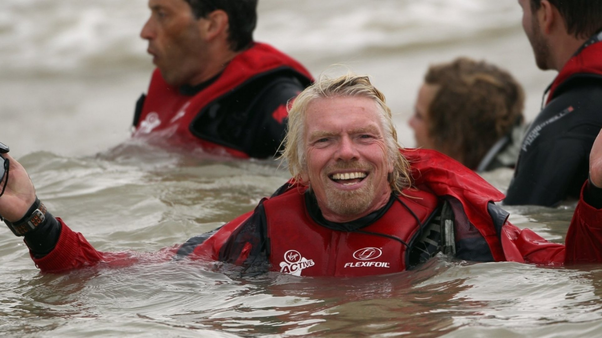 Richard Branson floats in the sea after failing in his attempt to Kite Surf across the English Channel on August 25, 2010 in Dungeness, England. Due to weather conditions, Branson had to call off the attempt, which was to celebrate his 60th birthday, and have him become the oldest person to Kite-surf across the English Channel.