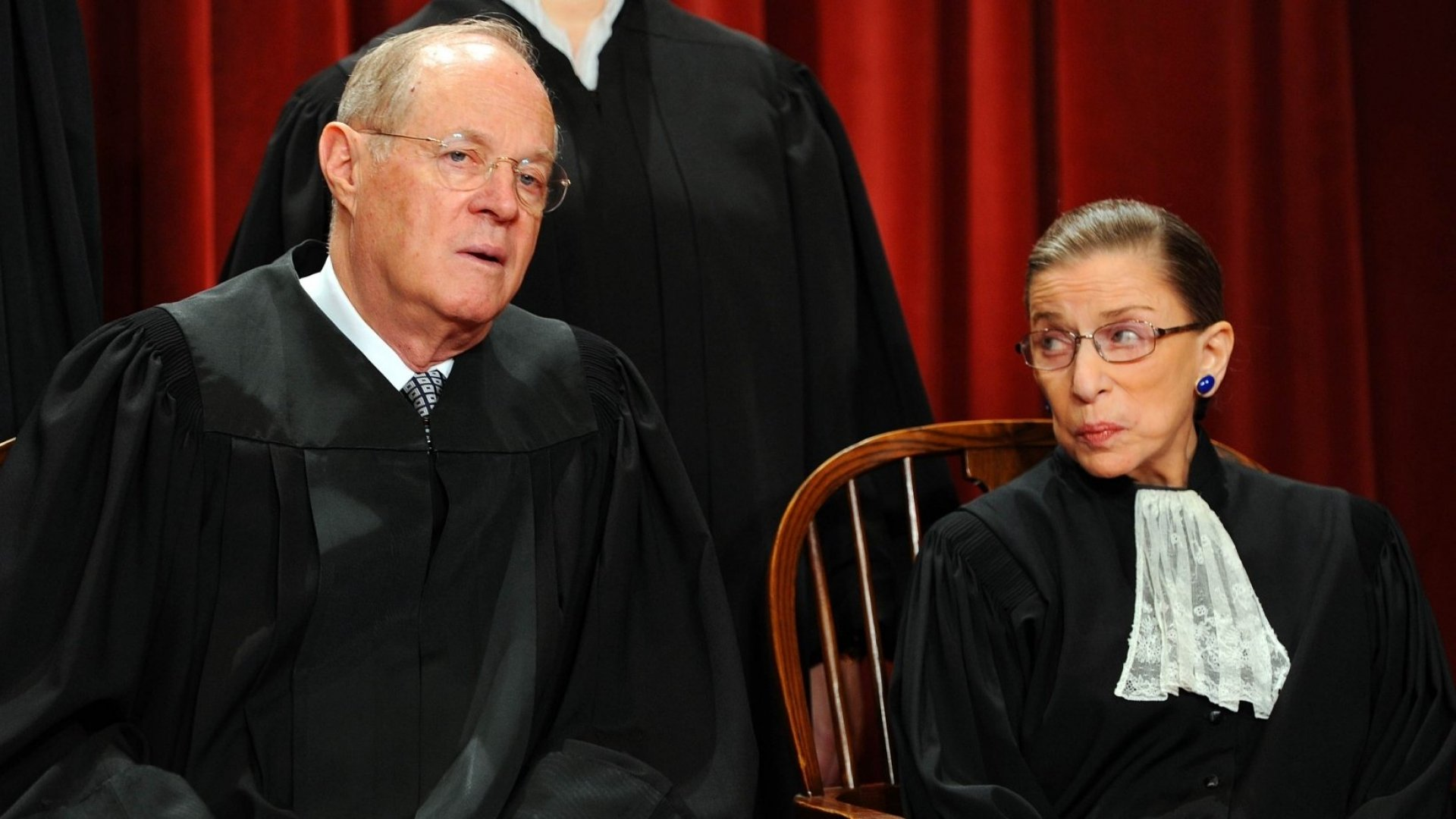 U.S. Supreme Court Associate Justice Anthony M. Kennedy (L) and Associate Justice Ruth Bader Ginsburg participate in an official photo session on October 8, 2010, at the Supreme Court in Washington, D.C.