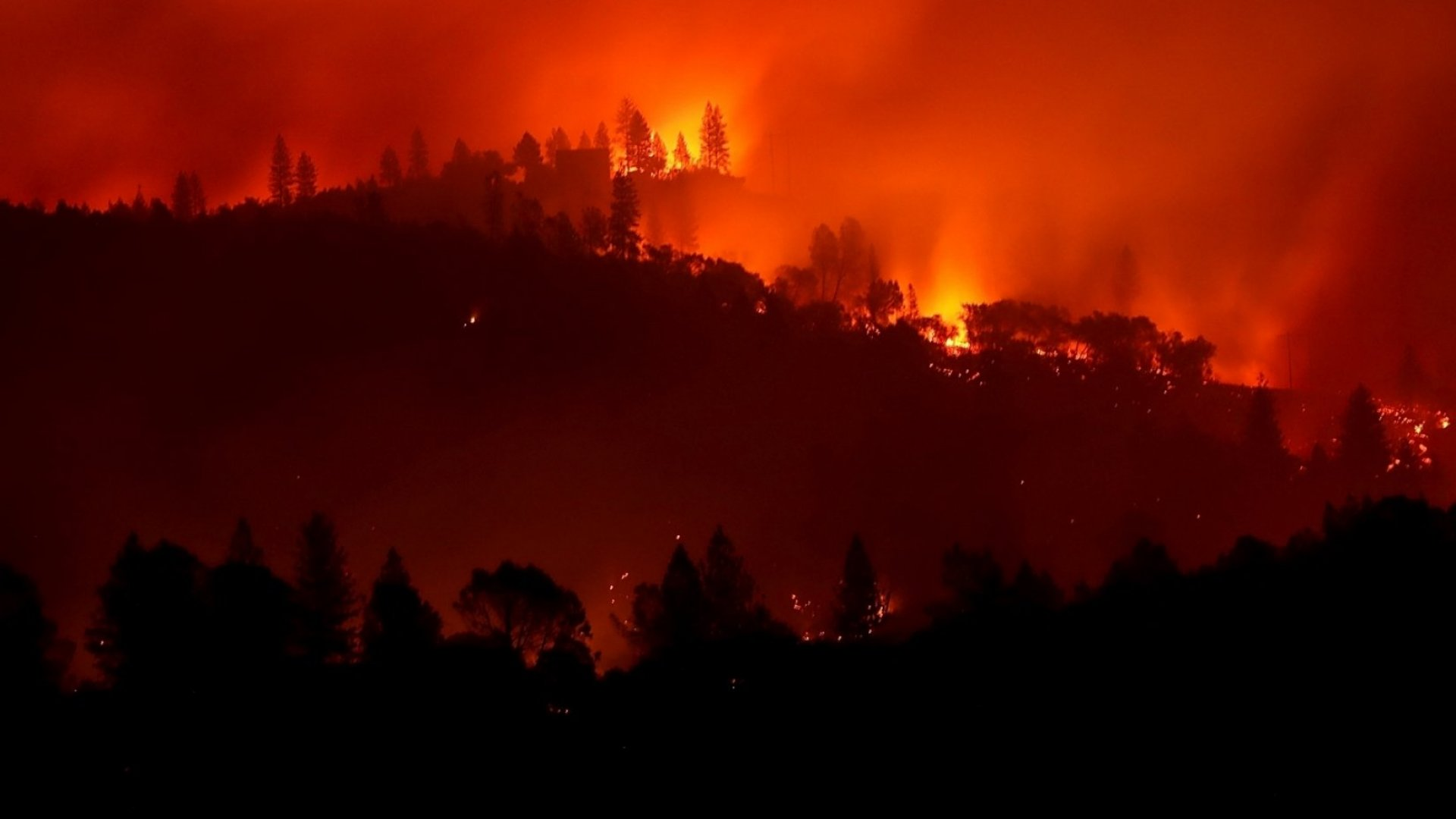 The Camp Fire burning in the hills on November 10, 2018 near Ororville, California.