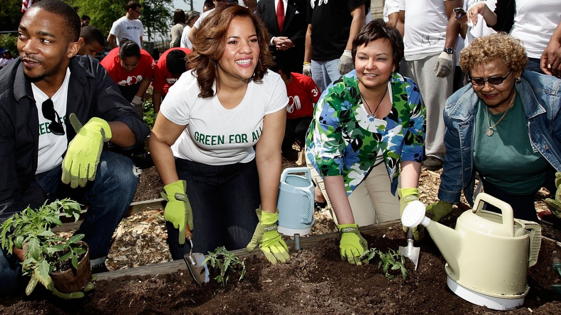 Phaedra Ellis-Lamkins, in white shirt, spent years as a labor and social-justice advocate before joining a tech startup. Here, as CEO of Green For All, an antipoverty organization, she participates in an Earth Day 2010 event with actor Anthony Mackie and former EPA administrator Lisa Jackson, among others. (Photo by Joe Kohen/WireImage)