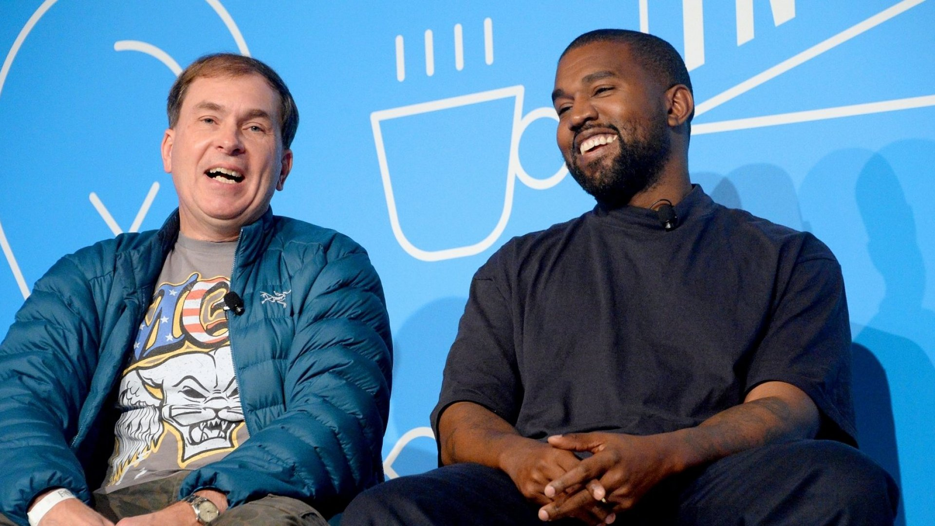 Kanye West onstage with designer Steven Smith at the Fast Company Innovation Festival.