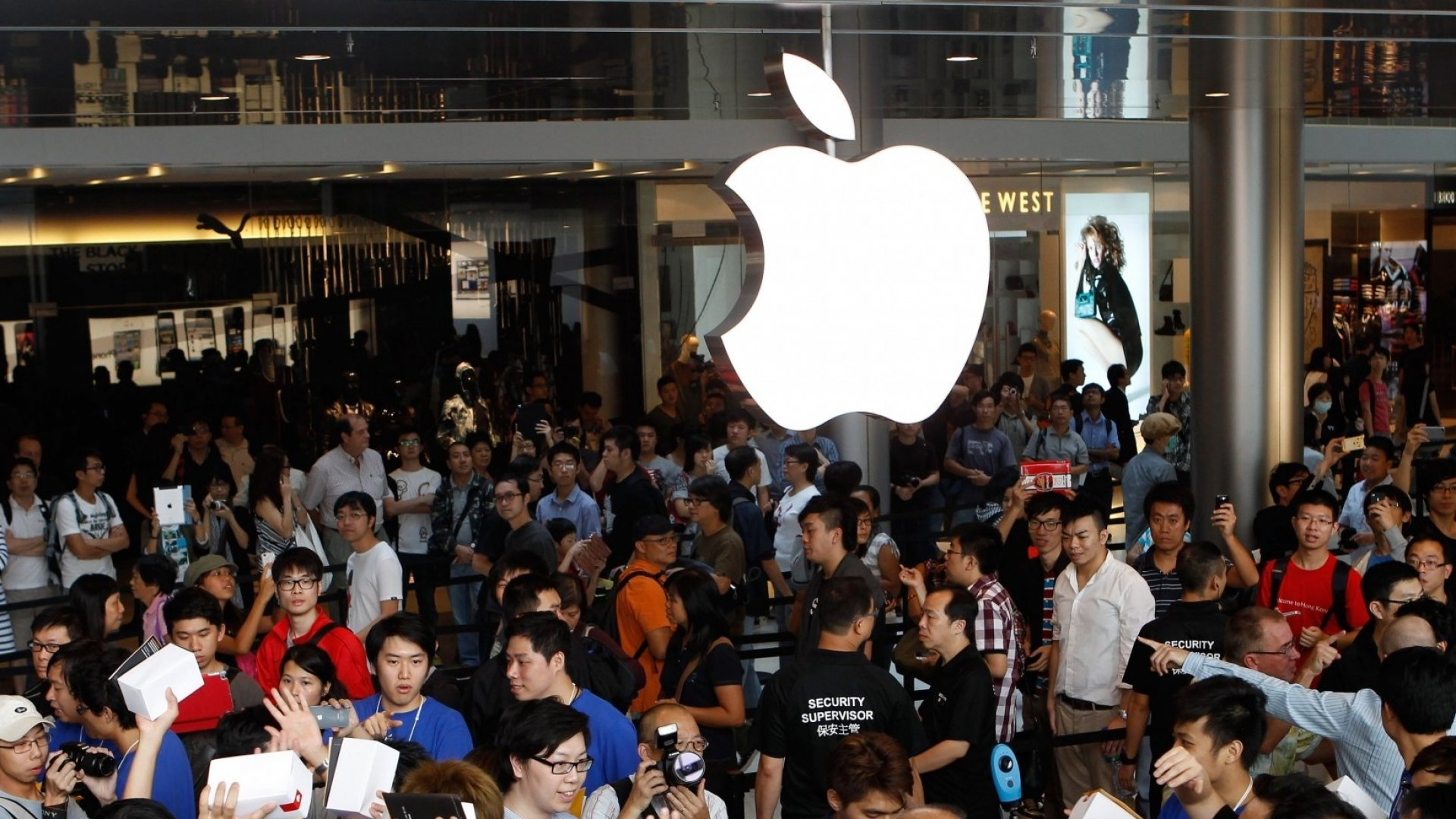 Customers at the first Apple store in Hong Kong.