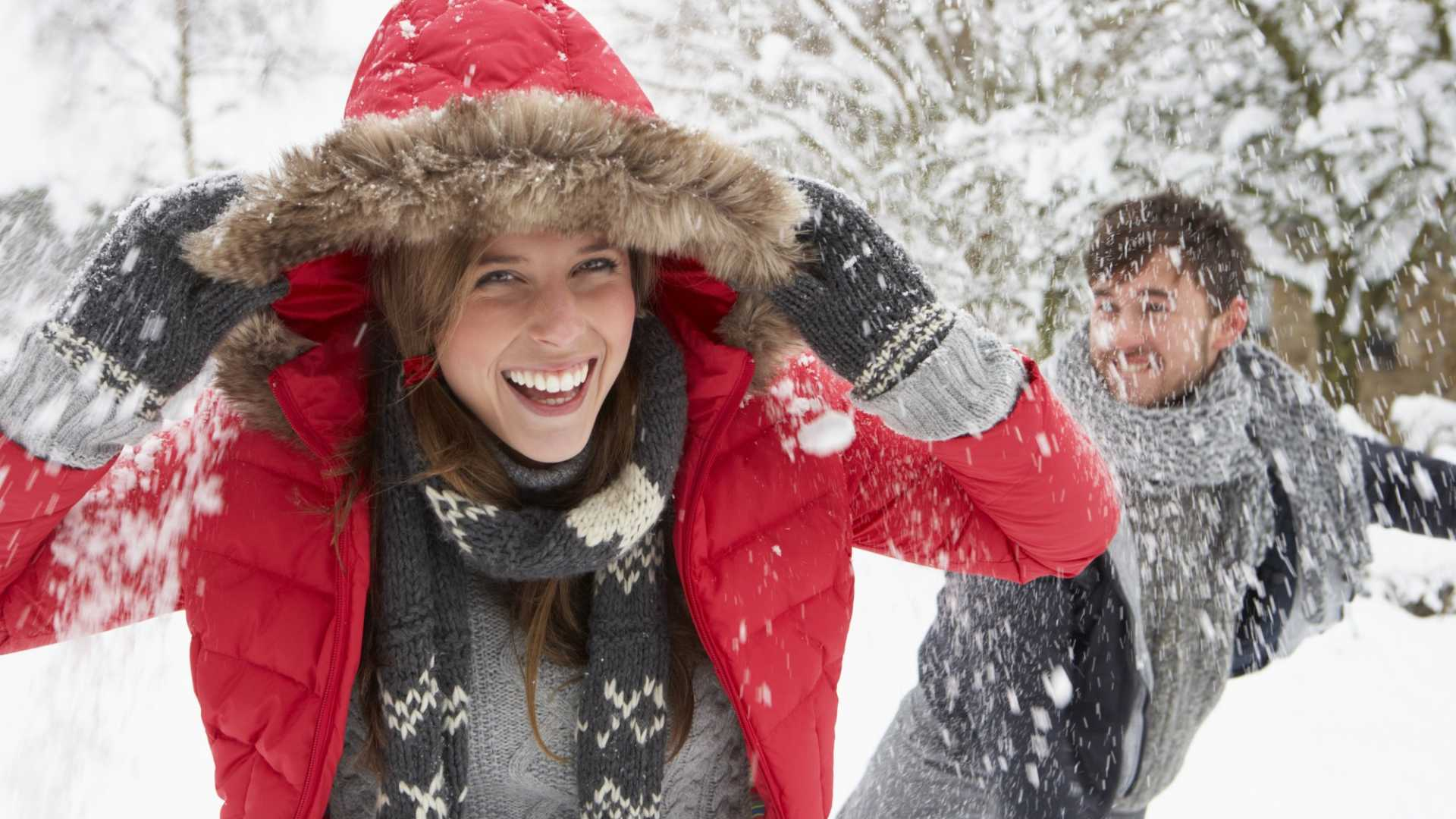 Happy couple building valuable prefrontal cortex circuits in a snowball fight.