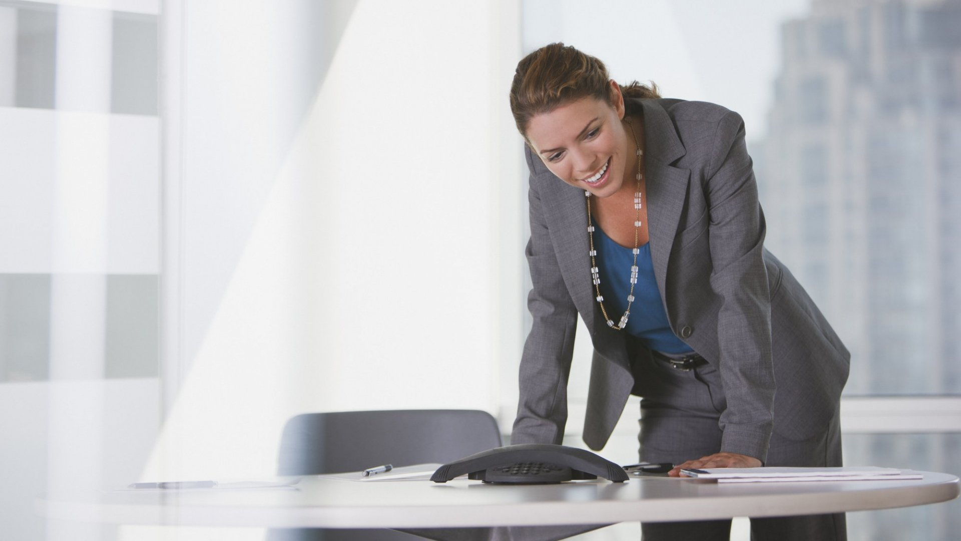 On a Conference Call, You Have to Act Charismatic (Even If You're Not). Here's How