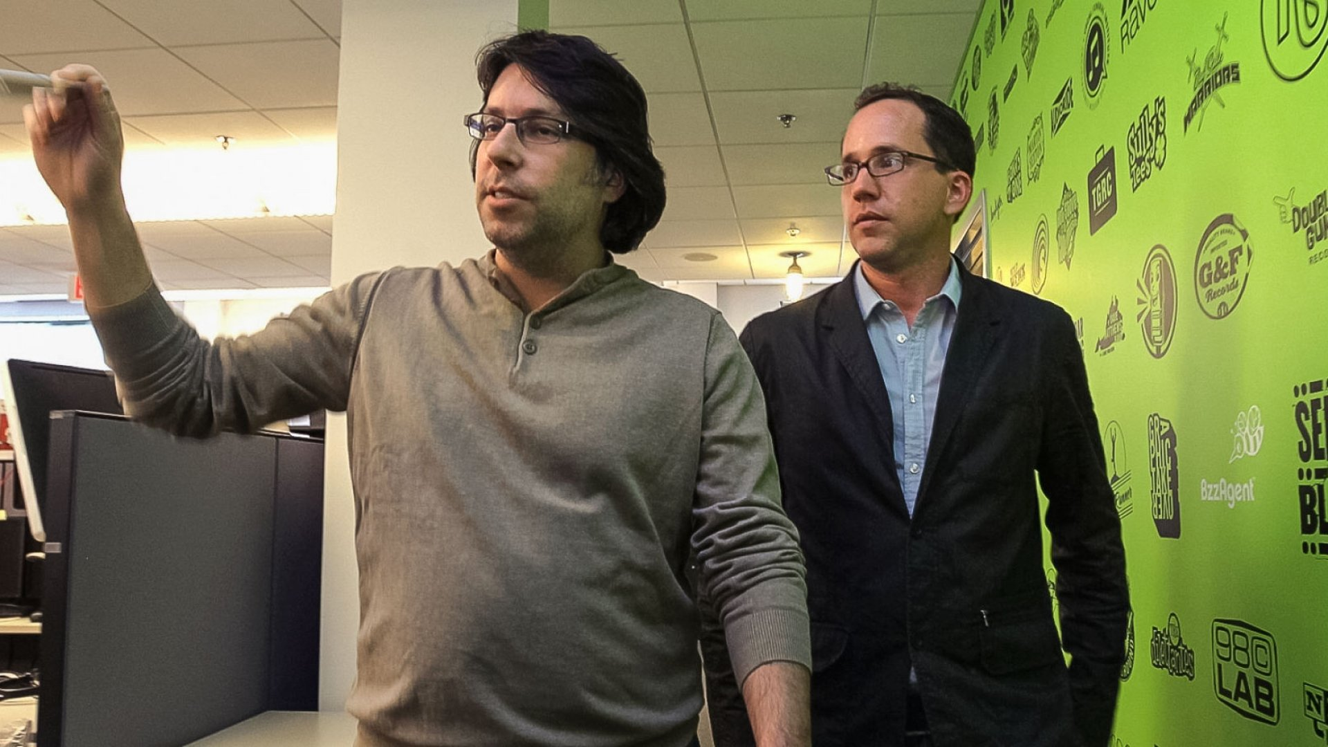 Dave Balter, at left, founder and CEO of BzzAgent takes Brian Drewes, Executive Producer of ZERO Visual Effects on a tour of BzzAgent during a meeting at his company's offices.