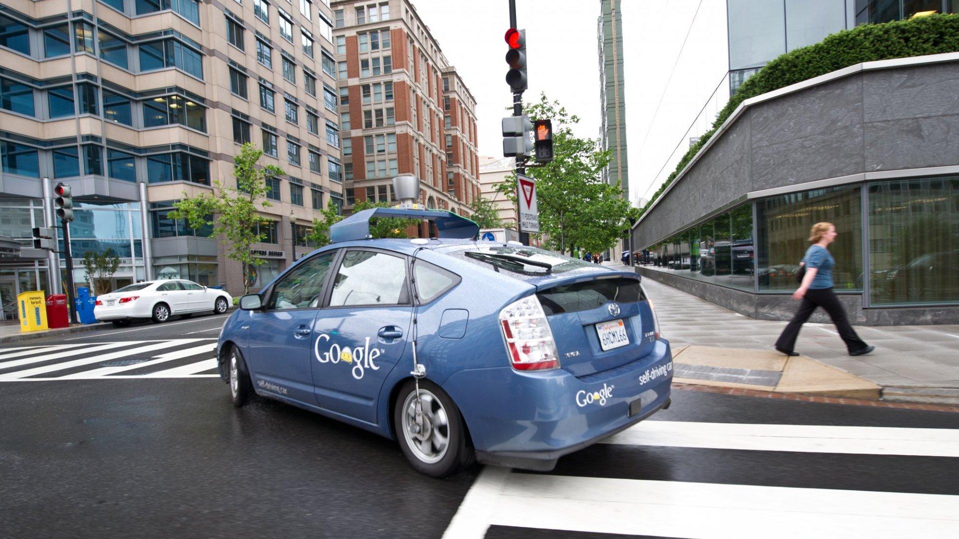 A Google self-driving car makes a right turn on a Washington, D.C. street.