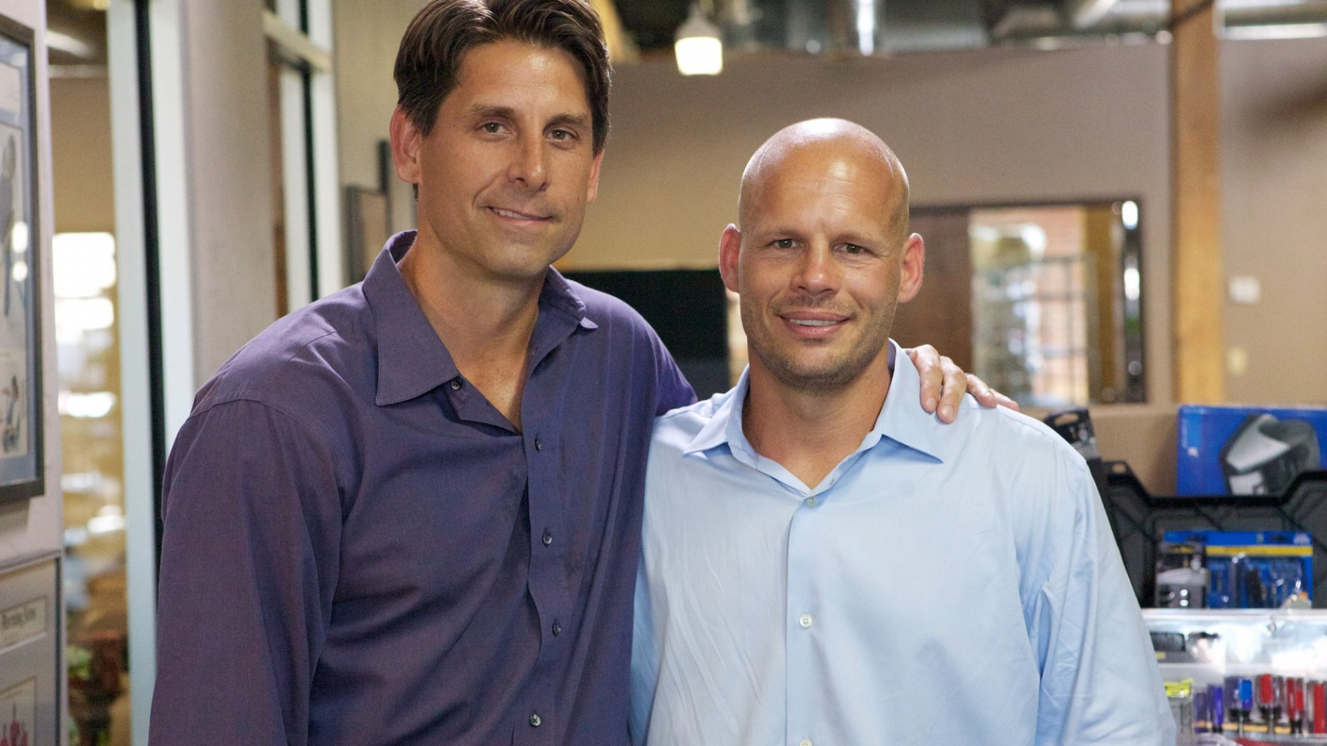 Chuck Runyon (left) with business partner Dave Mortensen at Anytime Fitness HQ