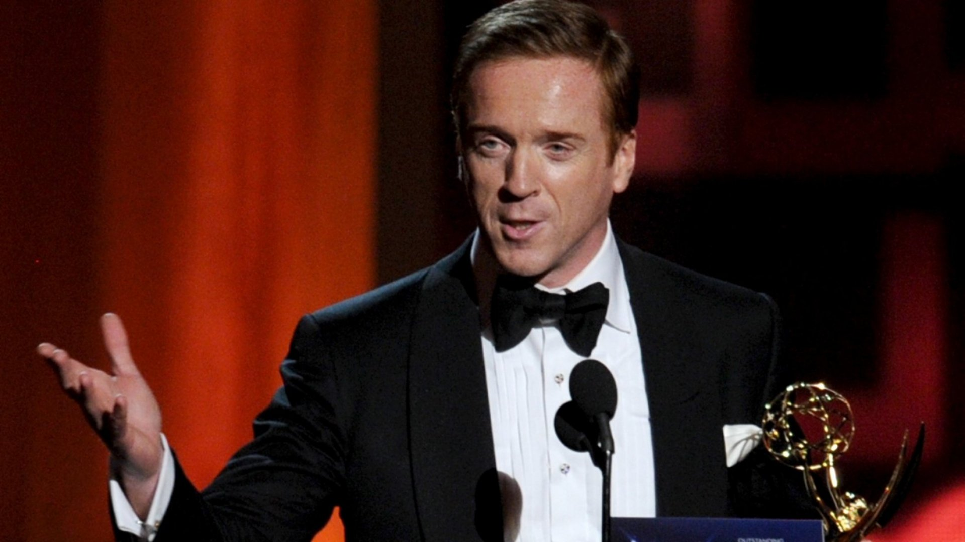 Homeland actor Damien Lewis receiving an Emmy for his portrayal of a spy under investigation by the CIA.