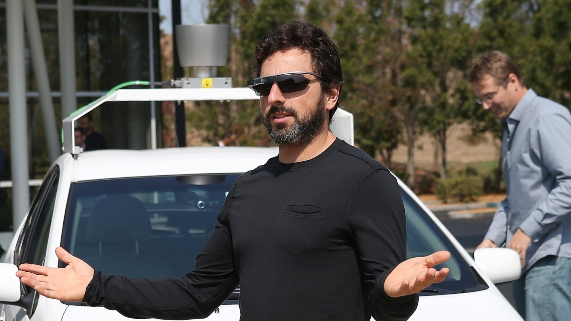 Google Co-Founder Sergey Brin (with Google Glass and one of the company's self-driving cars)