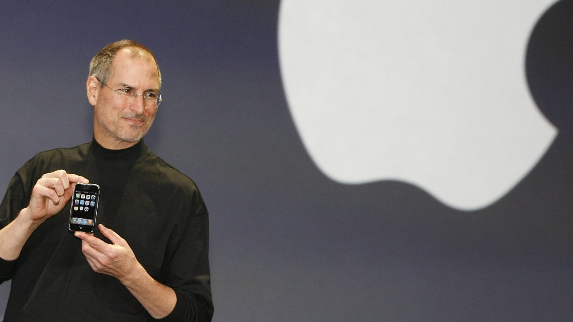 Steve Jobs unveils the first iPhone at the Macworld Conference in January 2007.