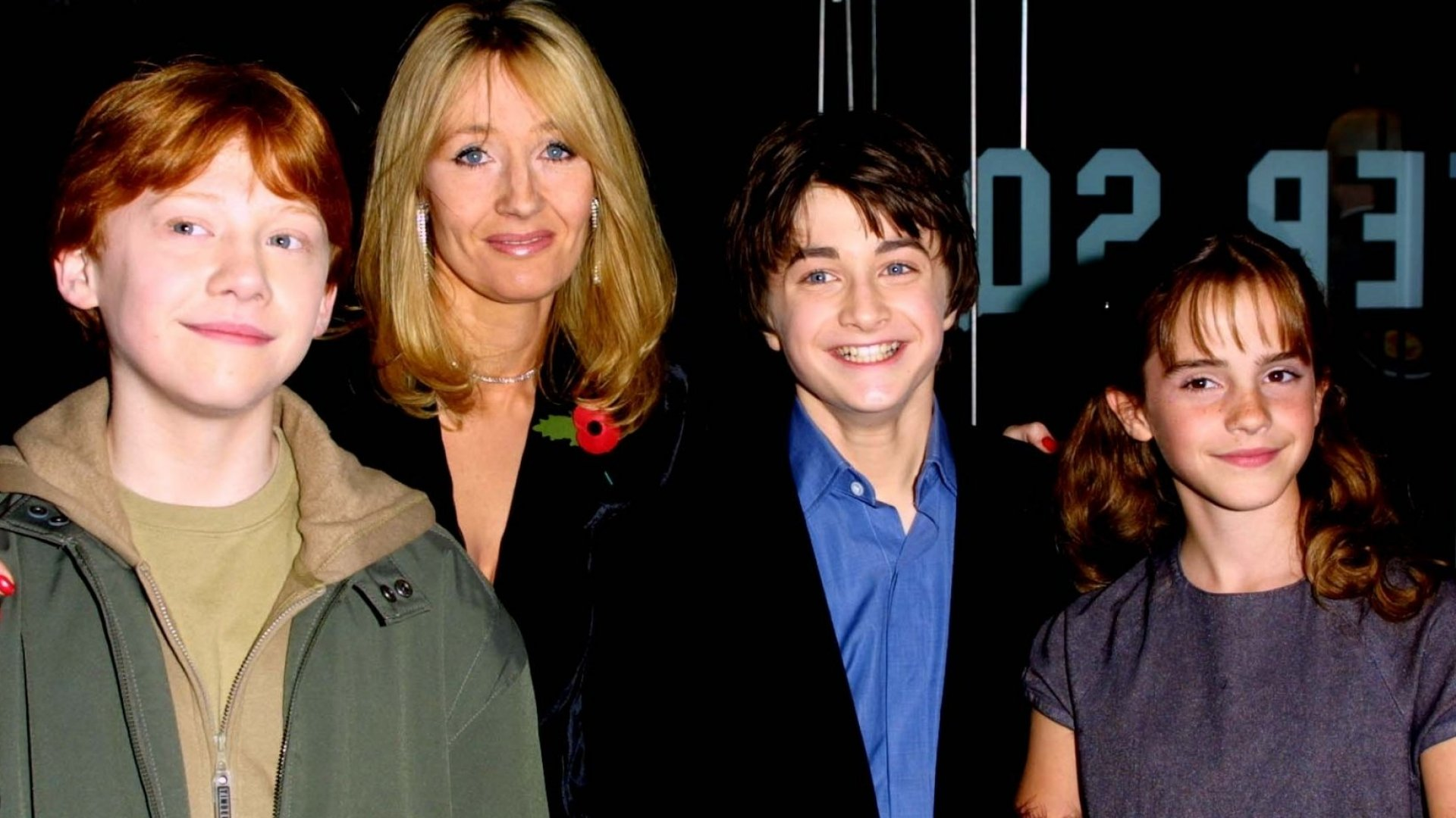 """Rupert Grint, J.K. Rowling, Daniel Radcliffe, and Emma Watson at the premiere of the movie """"Harry Potter and the Sorceror's Stone"""" in 2001."""