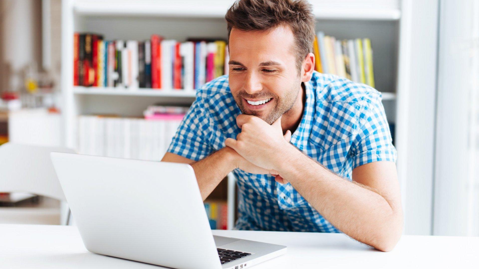 Happy sales  guy watching sales roll in after his webinar