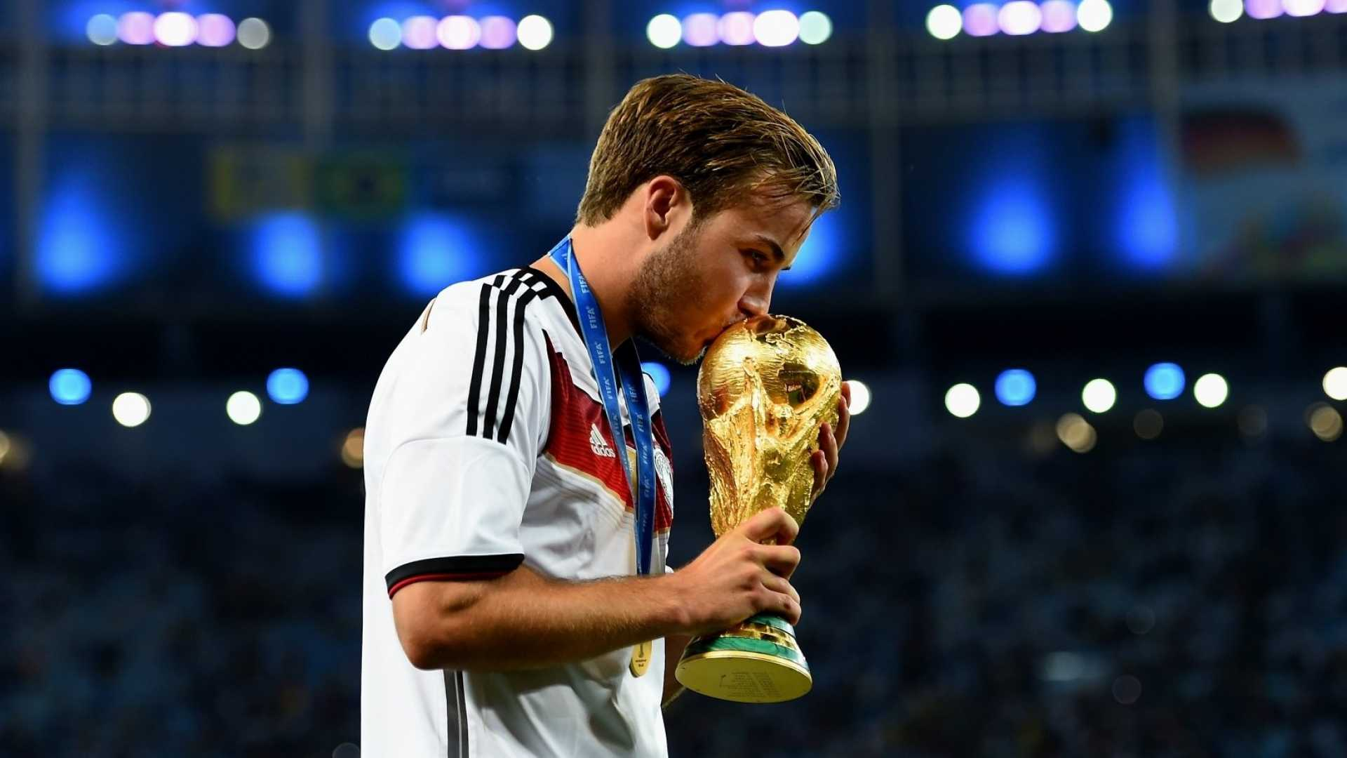 Mario Götze of Germany kisses the World Cup trophy after the 2014 FIFA World Cup Brazil final match. Unanimous's A.I. has predicted the results of the 2018 FIFA World Cup.