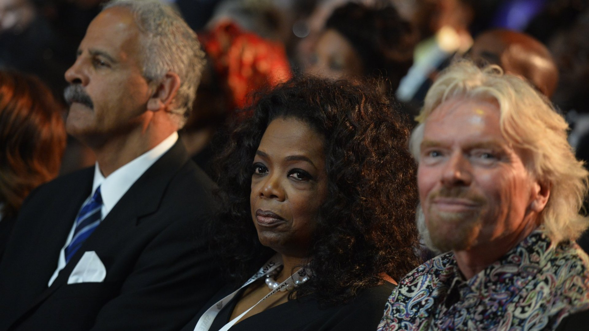 Oprah Winfrey (center) and Richard Branson (right).