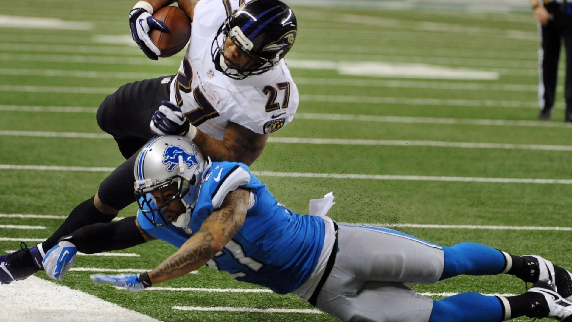 Glover Quin makes a tackle against the Baltimore Ravens.