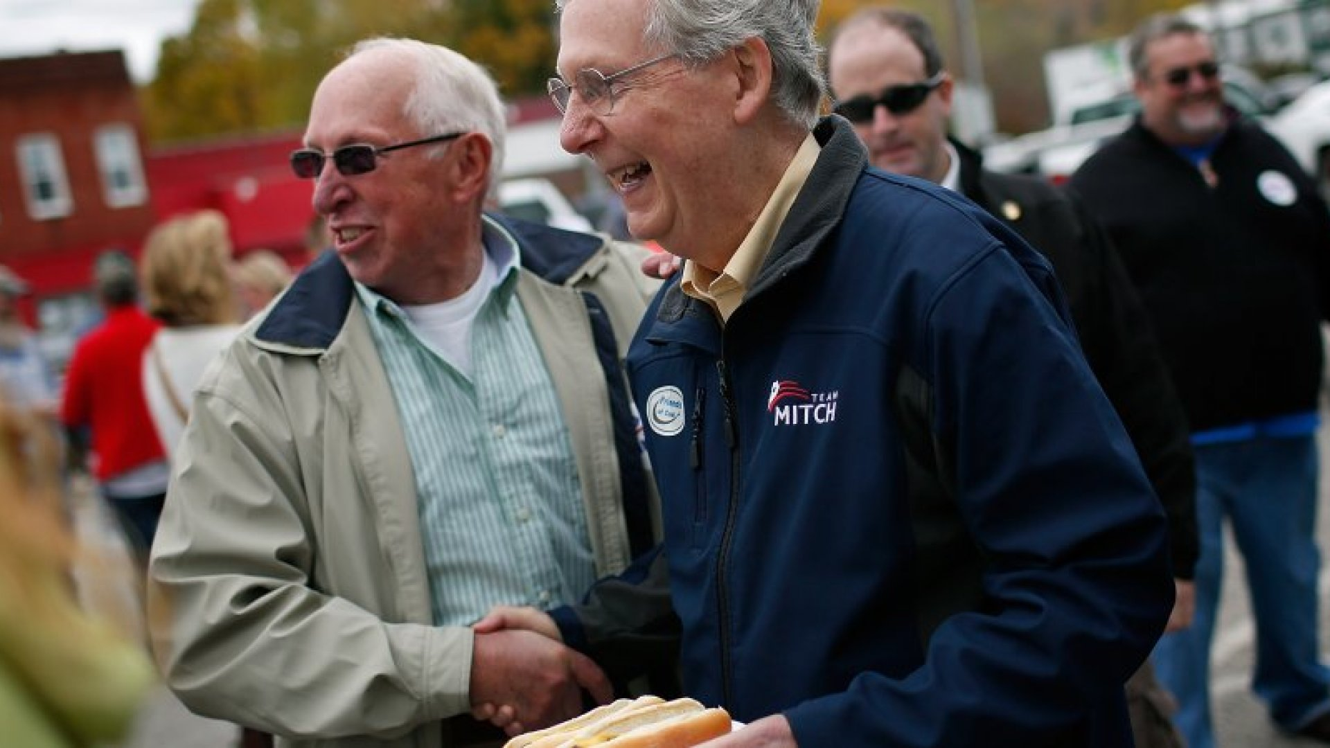 Senate Minority Leader Mitch McConnell (R-KY) (R) greets Kentucky voters after speaking at a campaign rally October 22, 2014 in Vanceburg, Kentucky. McConnell remains locked in a tight race with U.S. Senate Democratic candidate and Kentucky Secretary of State Alison Lundergan Grimes. (Photo by Win McNamee/Getty Images)