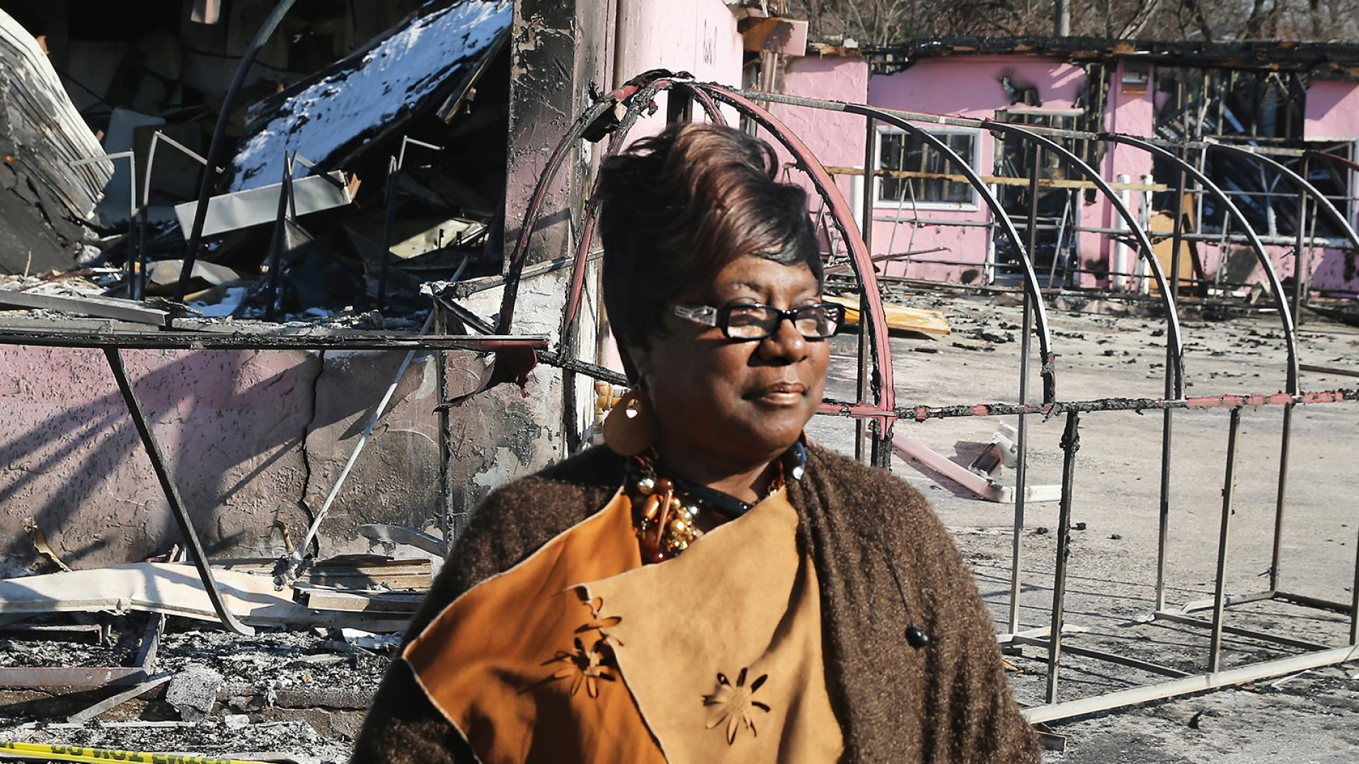 Juanita Morris surveys the remains of her business, Juanita's Fashions R Boutique, after it was destroyed by rioters on November 24, 2014, in Dellwood, Missouri.