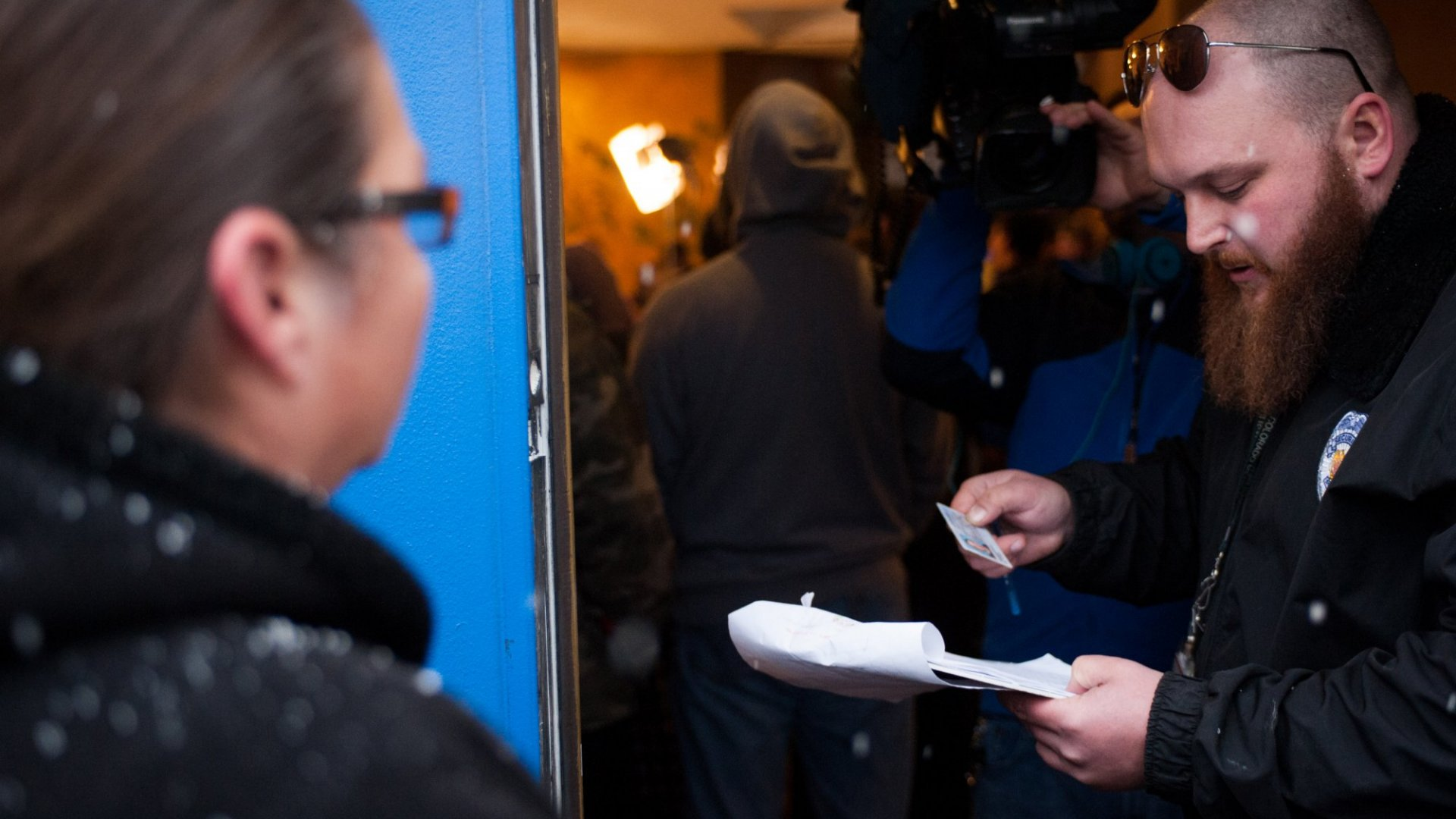 A security guard checks a woman's ID before she is allowed to enter one of Colorado's recreational marijuana dispensaries. Only adults 21 years of age or older are allowed inside dispensaries.