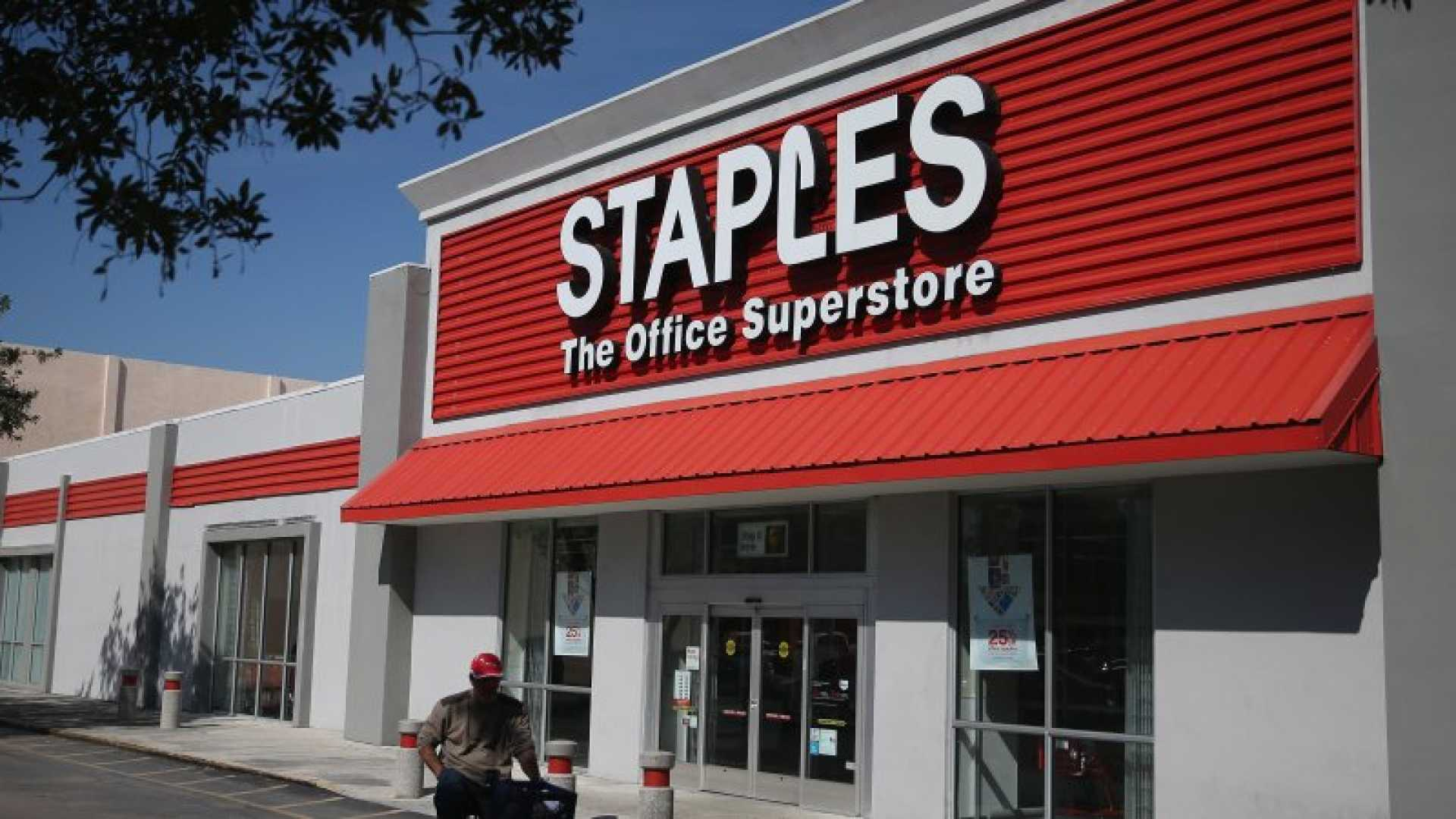 The sign logo for a Staples store is seen on February 3, 2015 in Miami, Fla. Staples is gobbling up competitor Office Depot in a $6 billion deal. (Photo by Joe Raedle/Getty Images)