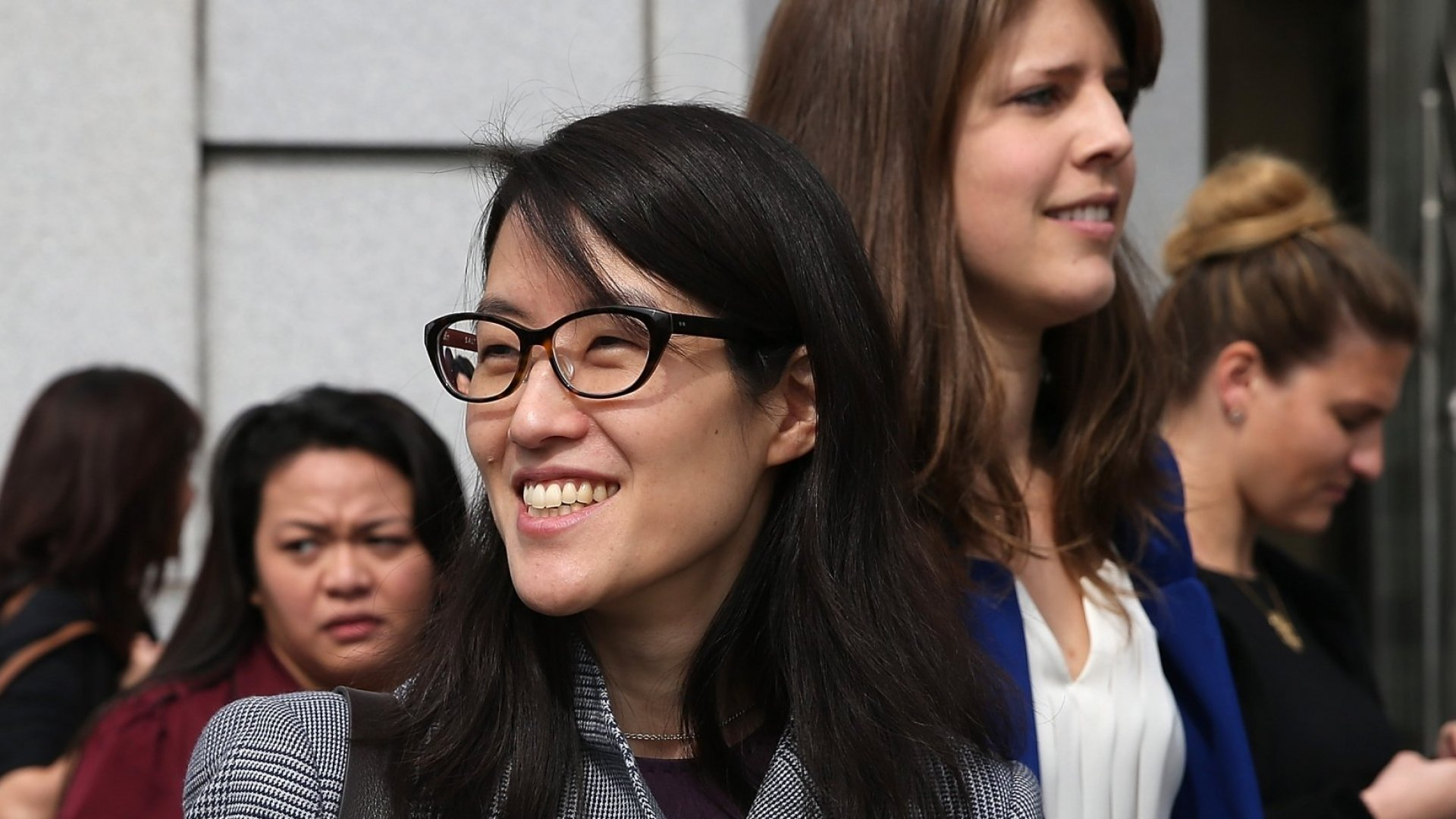 Ellen Pao (C) leaves the California Superior Court Civic Center Courthouse during a lunch break from her trial on March 10 in San Francisco. Pao, interim CEO of Reddit, is suing her former employer, Silicon Valley venture capital firm Kleiner Perkins Caulfield and Byers, for $16 million. (Photo by Justin Sullivan/Getty Images)