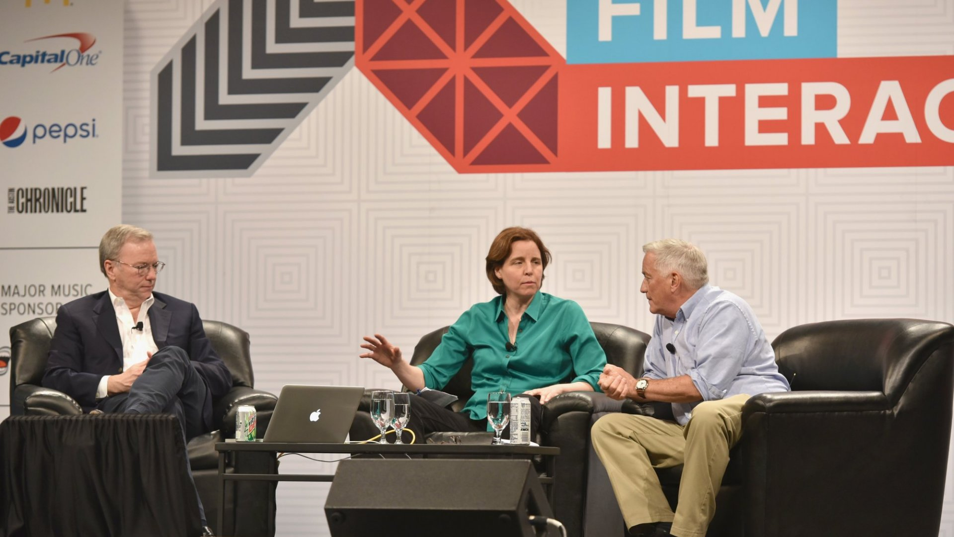 "Eric Schmidt, left, executive chairman of Google; Megan Smith, center, United States CTO in the Office of Science and Technology Policy; and Walter Isaacson, right, president and CEO of The Aspen Institute, speak onstage at ""How Innovation Happens"" on March 16 during the 2015 SXSW Music, Film + Interactive Festival in Austin, Texas. Schmidt faced some criticism for interrupting Smith during the talk. (Photo by Amy E. Price/Getty Images for SXSW)"