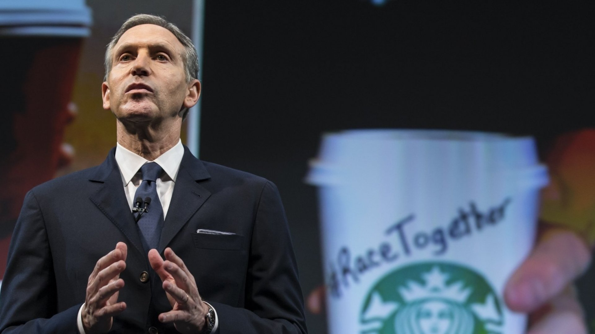 """Starbucks Chairman and CEO Howard Schultz addresses the """"Race Together Program"""" during the Starbucks annual shareholders meeting on March 18 in Seattle. The program is an effort to promote discussion on racial inequality in the United States. (Stephen Brashear/Getty Images)"""