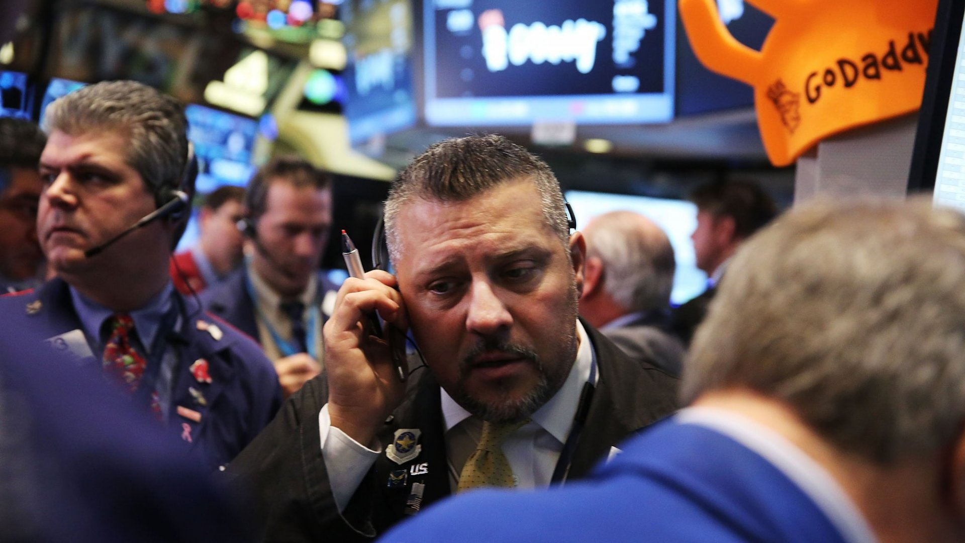 Traders working the floor as Go Daddy makes its official debut on the New York Stock Exchange on Wednesday.