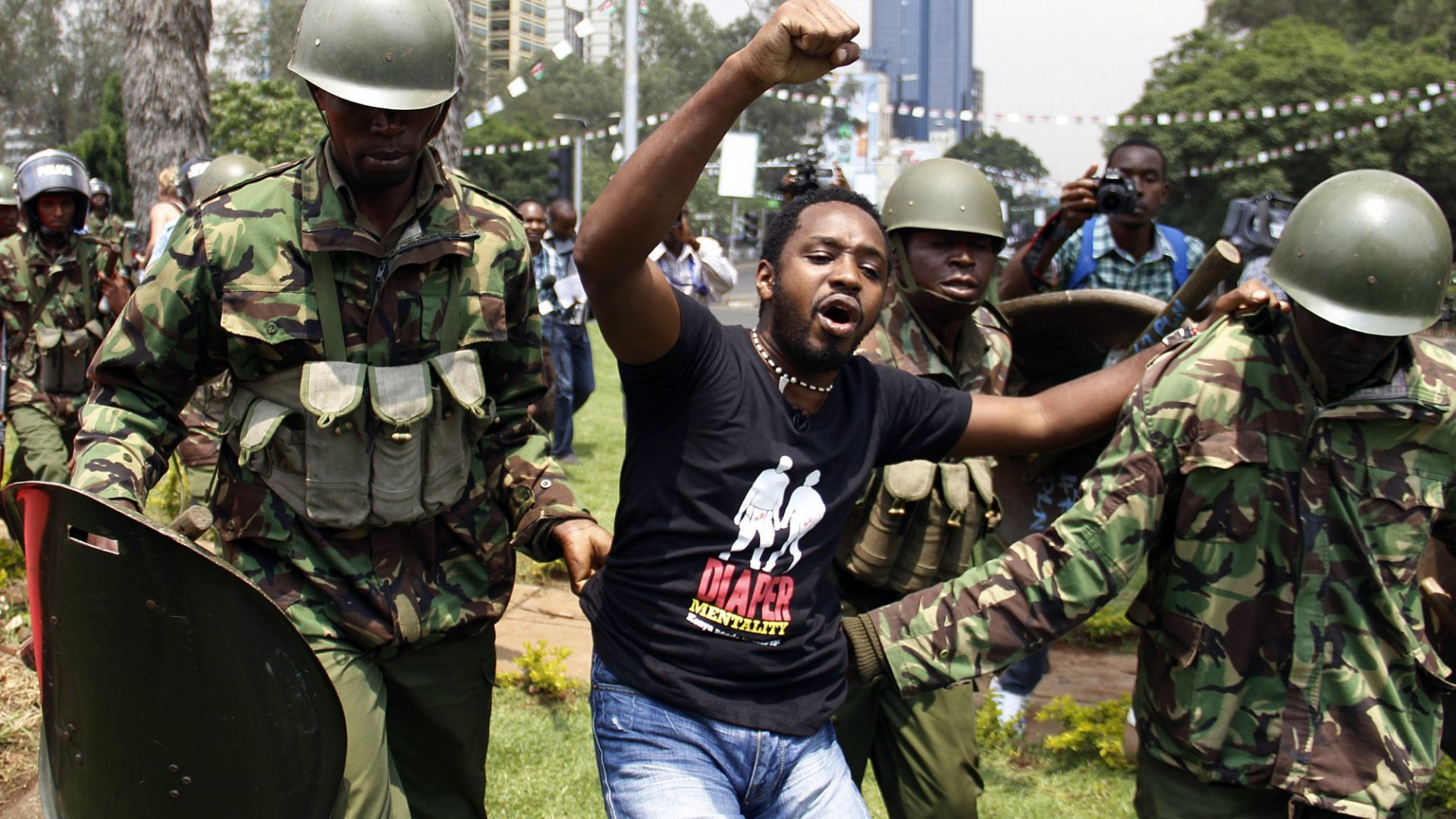 Kenyan activist Boniface Mwangi is arrested during a protest in Nairobi on February 13, 2014. The demonstration entitled 'State of the Nation' was held to protest against rising cases of corruption in the government, lack of safety in public places, high unemployment, and poverty.