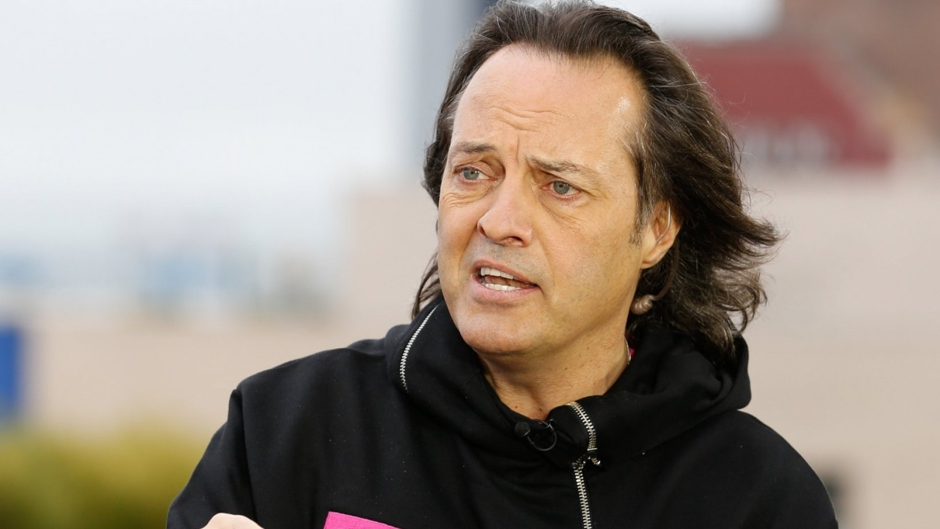 T-Mobile CEO John Legere will be the CEO of the merged company. Will he cut his hair?