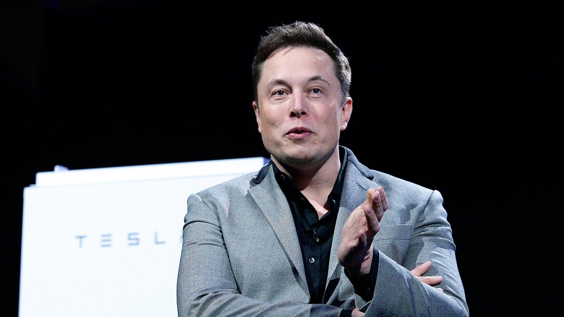 Elon Musk's unveiling Tesla's Powerwall and Powerpack batteries in April 2015.