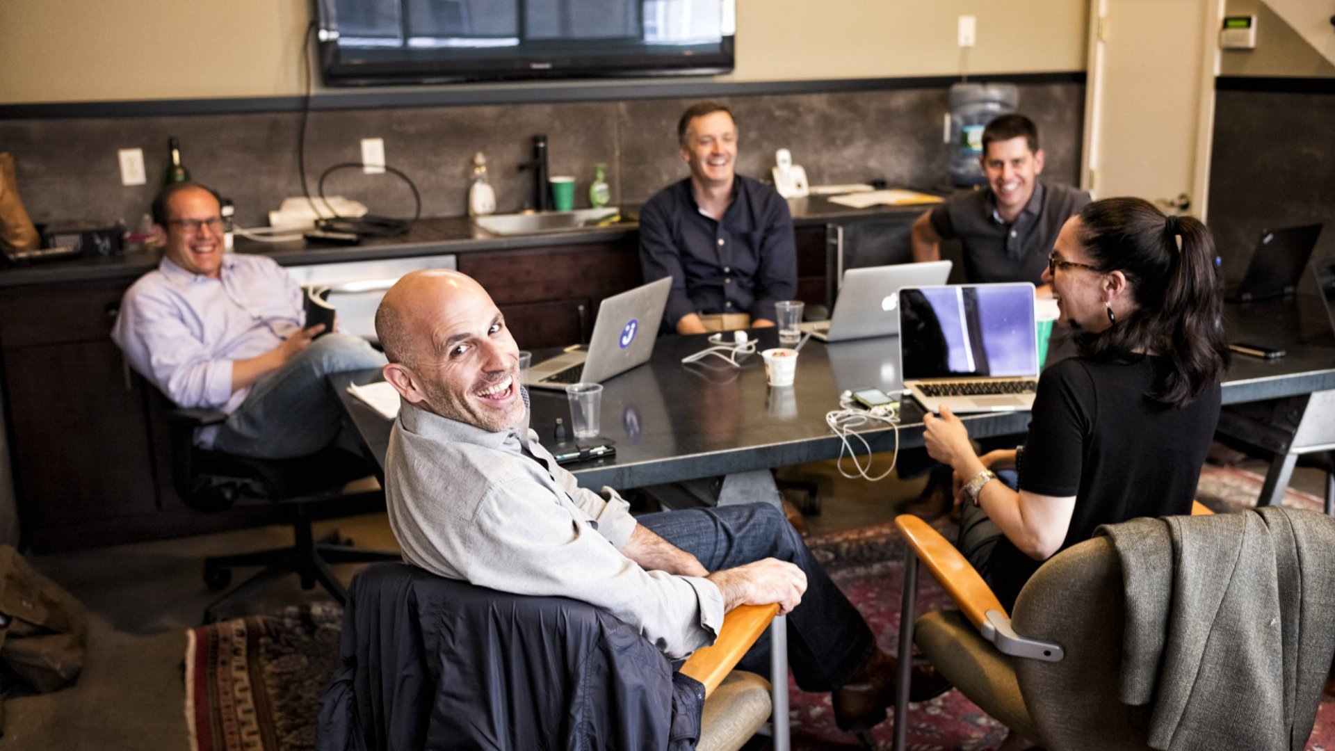 Marc Lore, CEO of e-commerce site jet.com, and his team smile at the photographer during the meeting in the conference room at jet.com headquarters in Montclair, New Jersey.