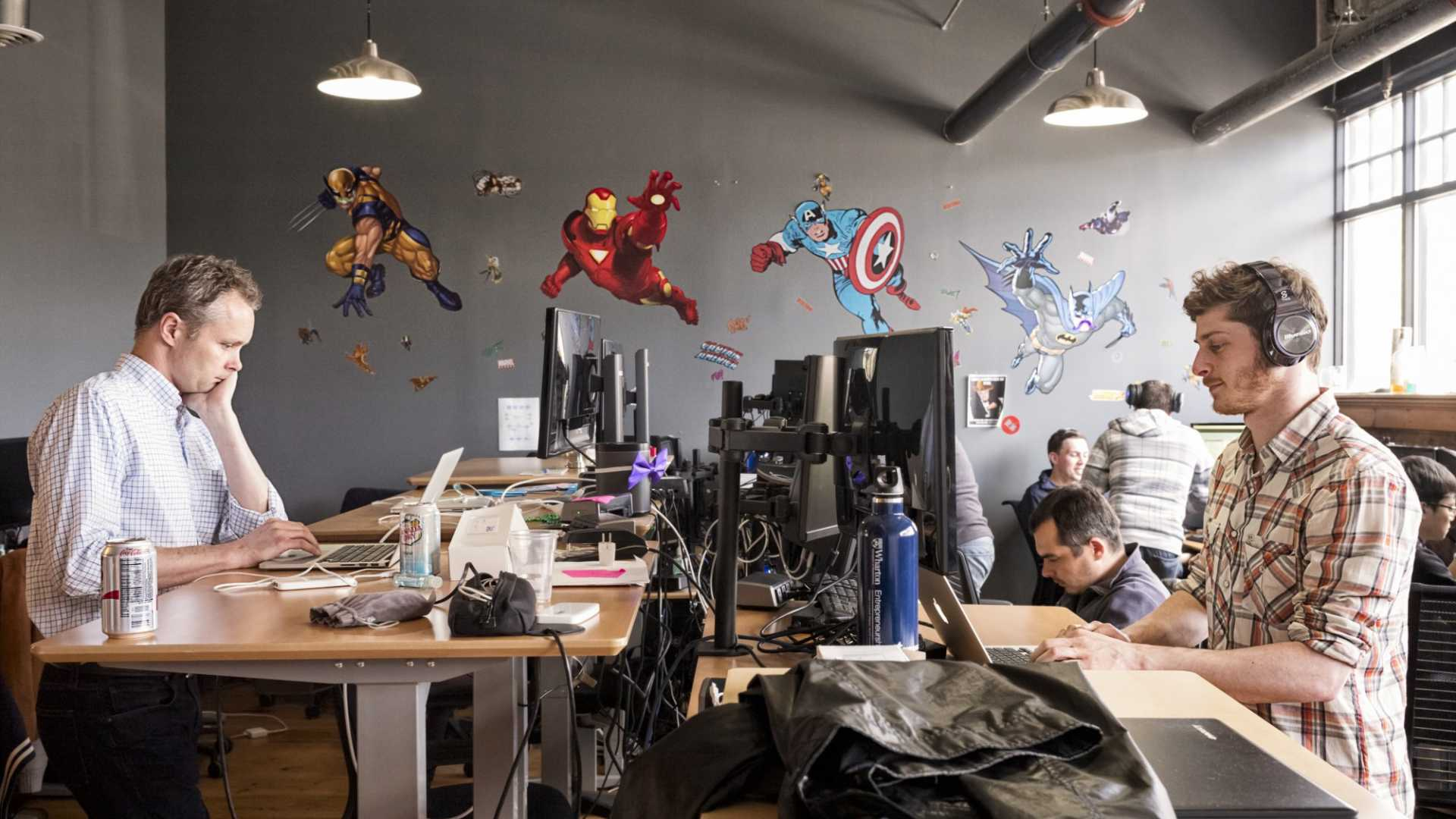 Employees working at standing desks in e-commerce company Jet.com's Montclair, New Jersey, office.