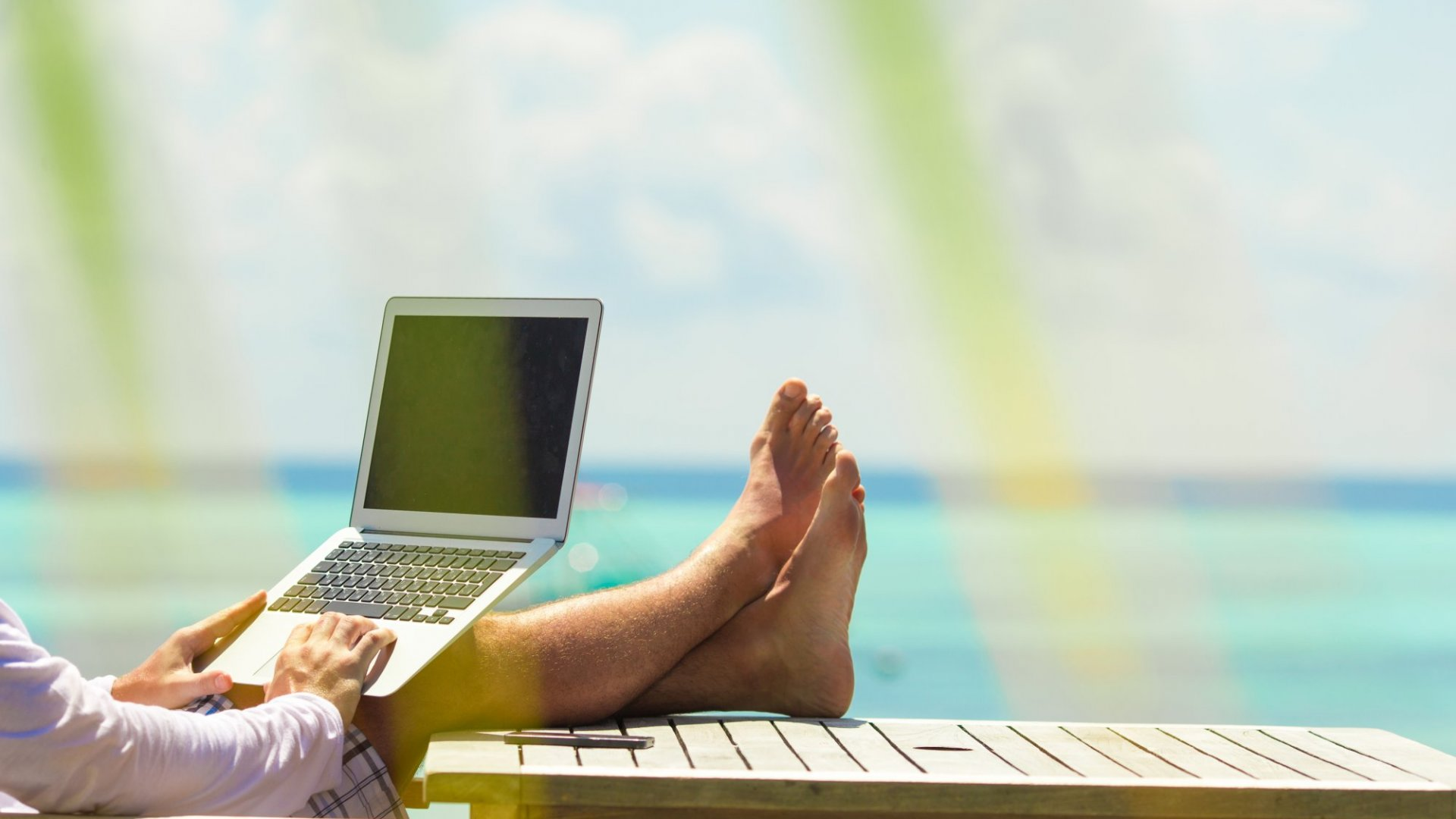 Allow employees to work from where they want, even if it's a beach