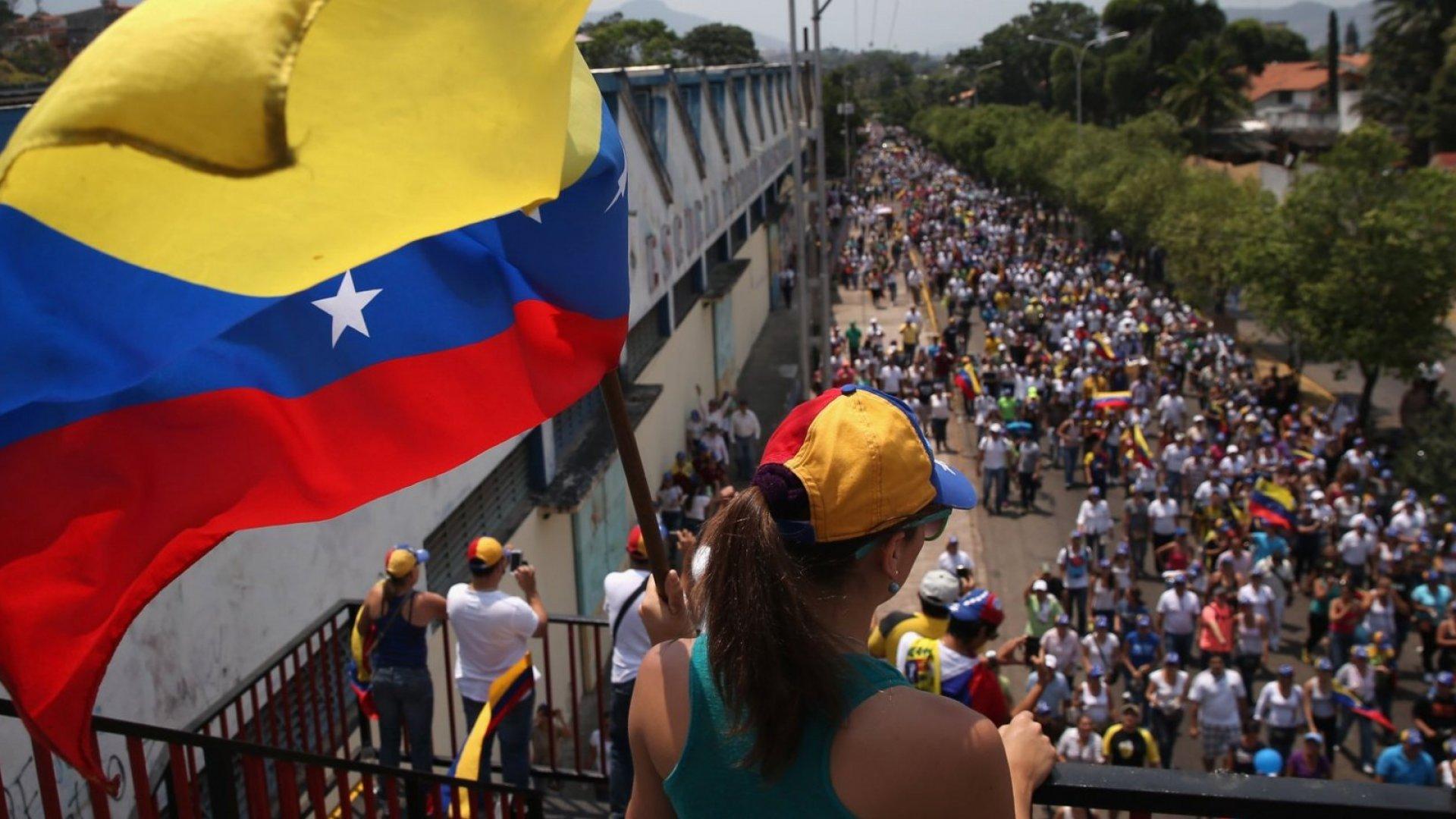 Anti-government protestors march through San Cristobal, Venezuela last year.