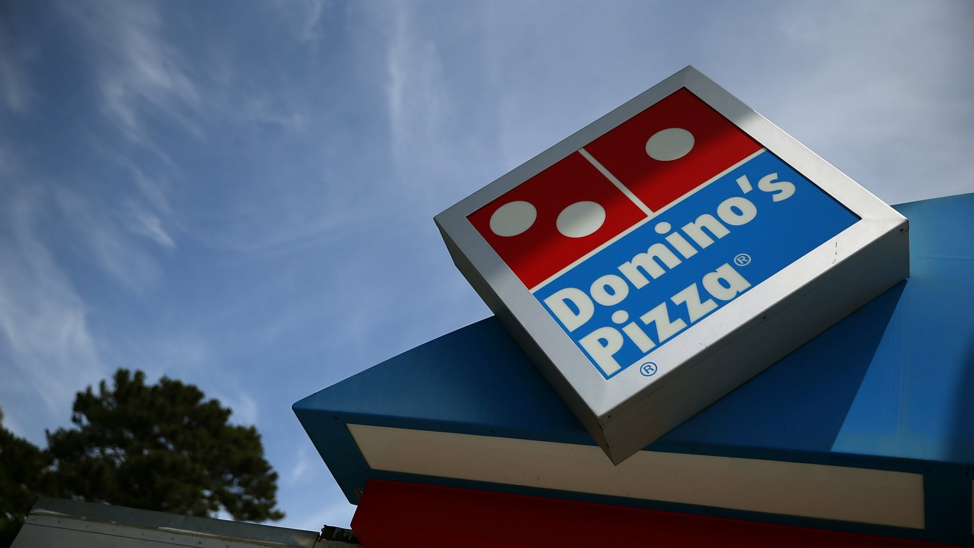 Domino's Has a New Strategy: Do the Opposite of What Pizza Hut and Papa John's Are Doing