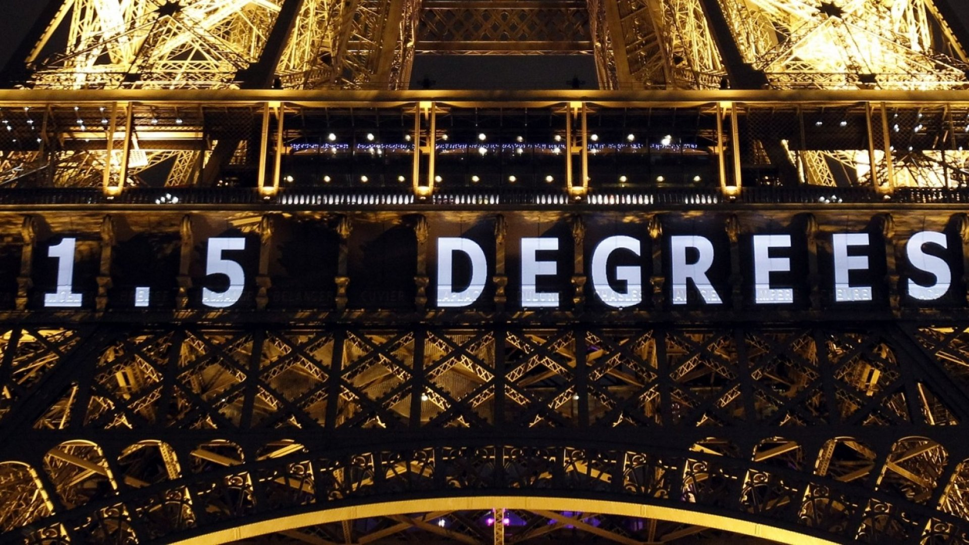 The slogan '1.5 Degrees' is projected on the Eiffel Tower as part of the World Climate Change Conference 2015 (COP21) on December 11, 2015 in Paris, France.