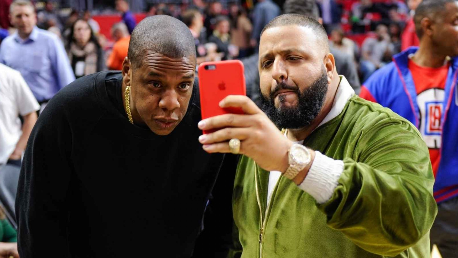 Jay Z (L) and DJ Khaled attend a basketball game between the Miami Heat and the Los Angeles Clippers