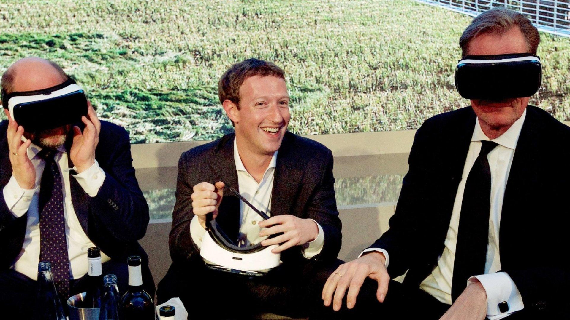 Mark Zuckerberg (center), co-founder and CEO of Facebook.