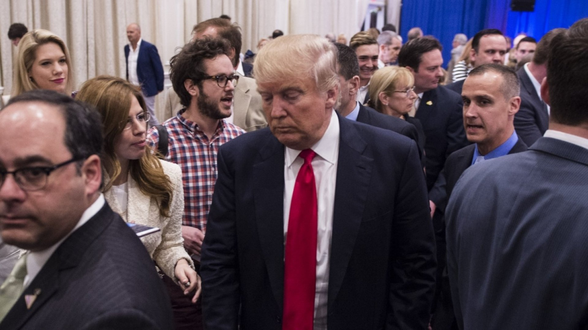 Donald Trump with reporter Michelle Fields and campaign manager Corey Lewandowski (wearing blue shirt). Moments later, video shows, Lewandowski grabbed Fields and shoved her aside.