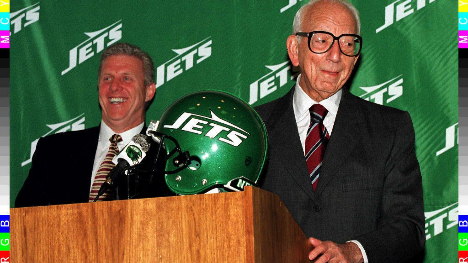Former New York Jets owner and legendary oil baron Leon Hess (r) smiles at the 1997 press conference where he introduced head coach Bill Parcells.